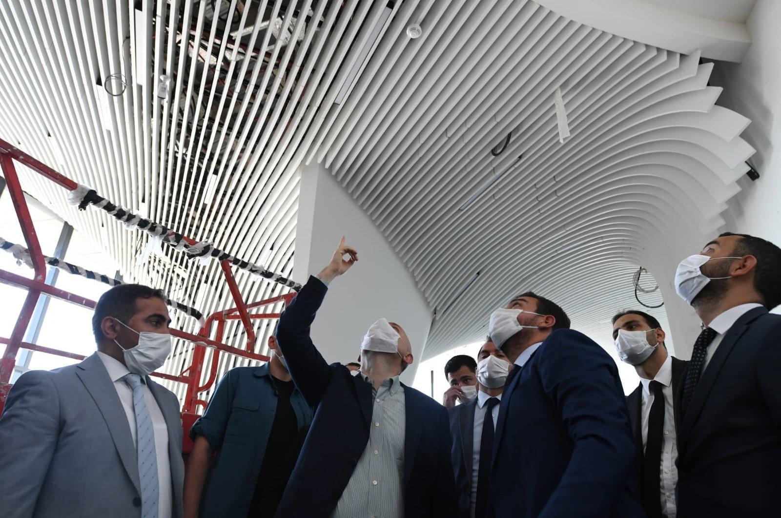 Transport and Infrastructure Minister Adil Karaismailoğlu (C) inspects the Çamlıca Tower on site in Istanbul's Üsküdar district, Turkey, Aug. 23, 2020. (DHA Photo)