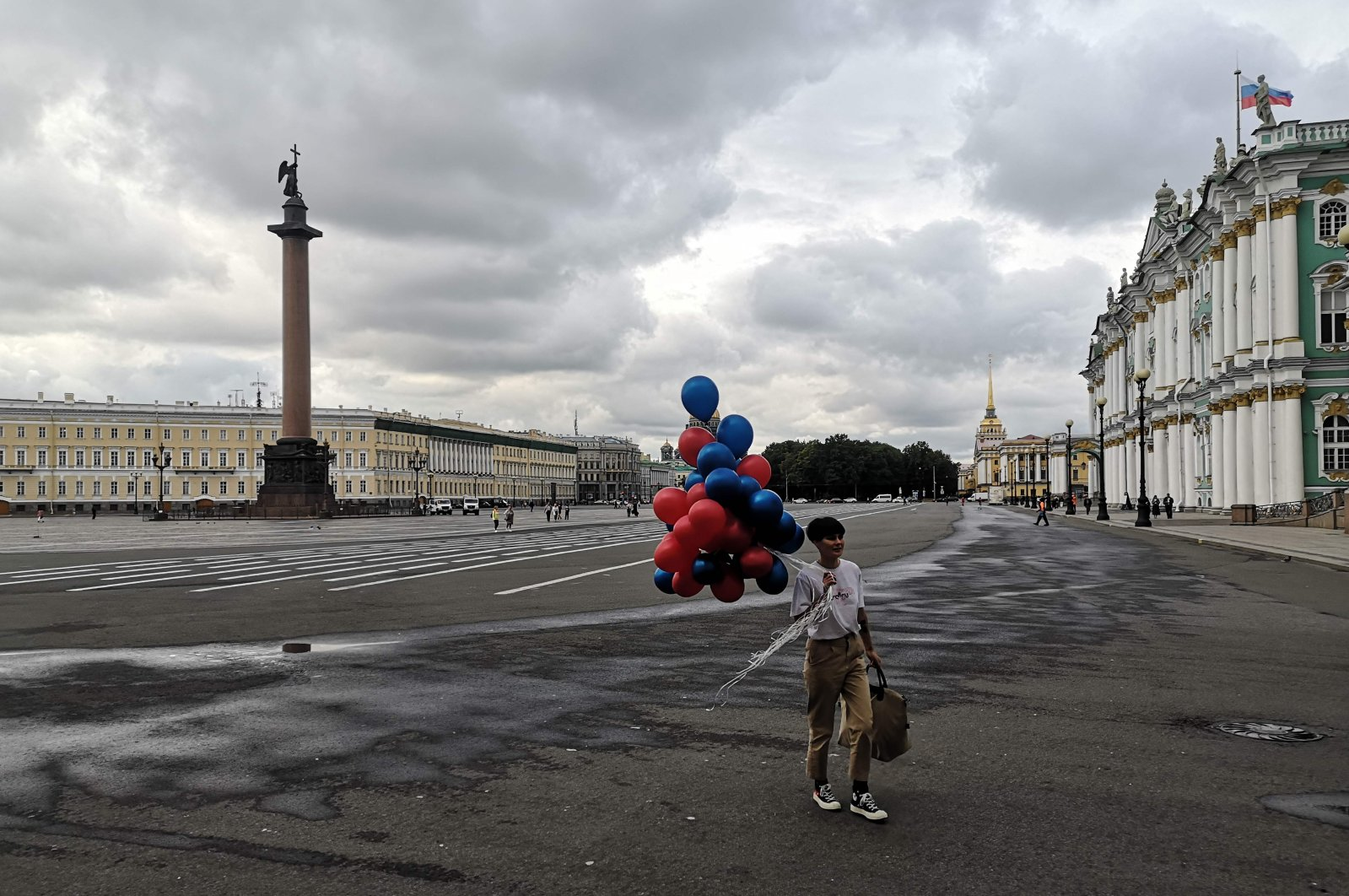 A woman walks with balloons on Palace Square in Saint Petersburg, Russia, Aug. 31, 2020. (AFP Photo)