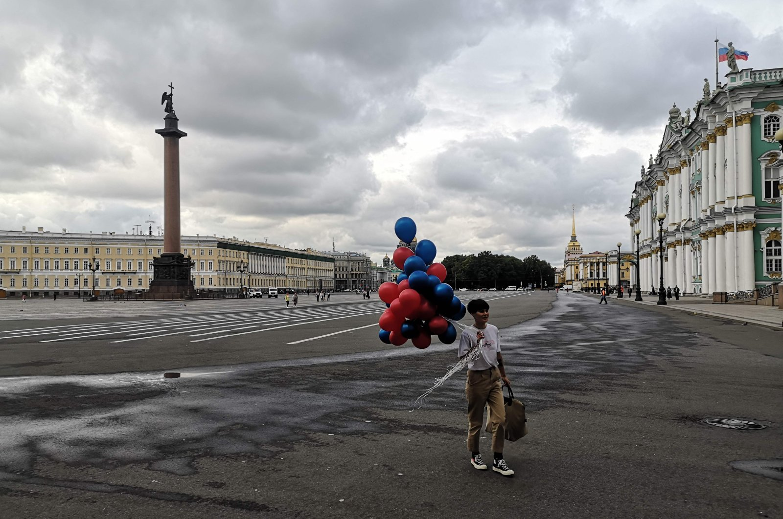 A woman walks with balloons on Dvortsovaya (Palace) Square in St. Petersburg, Russia, Aug. 31, 2020. (AFP Photo)