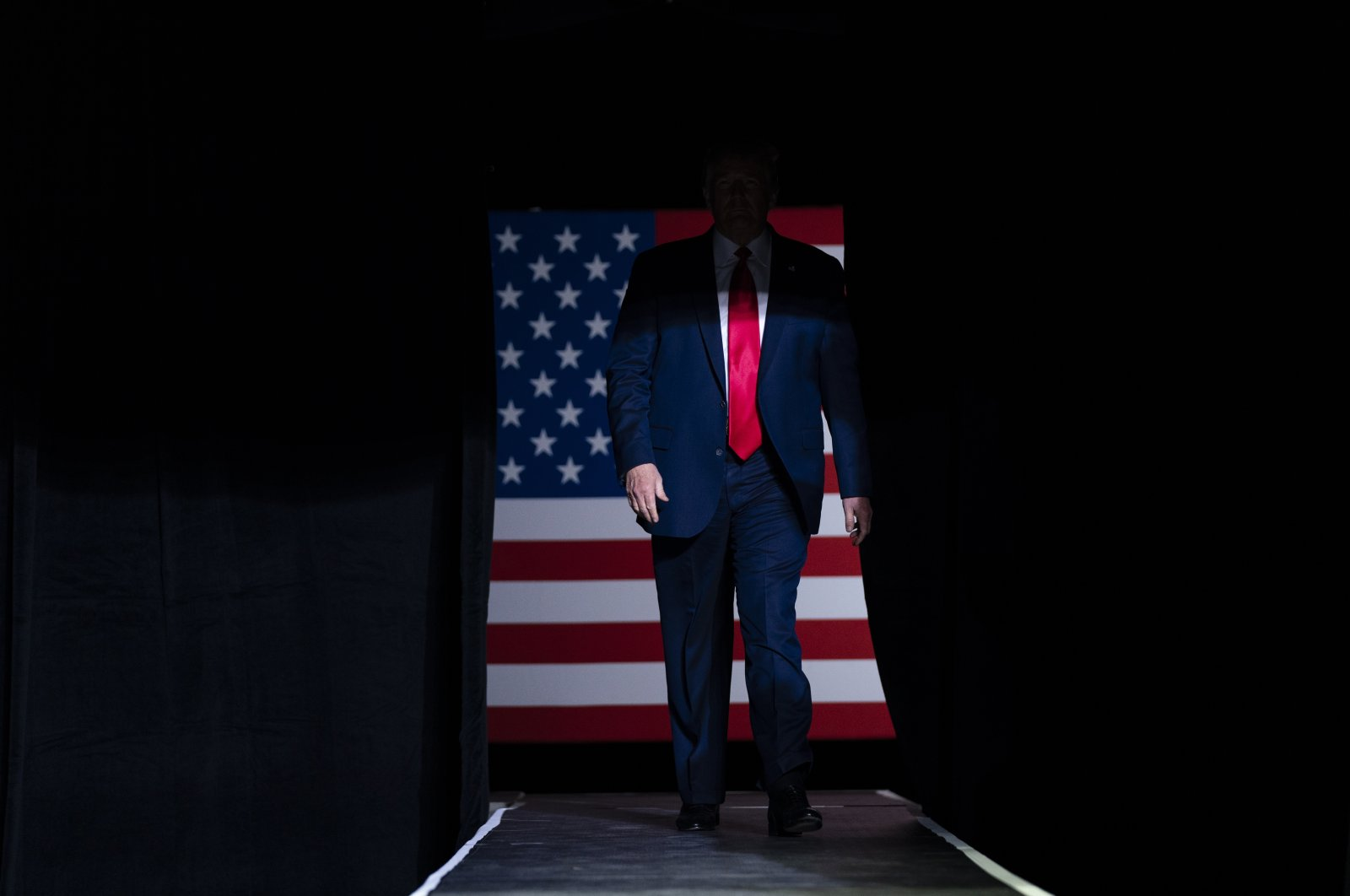 President Donald Trump arrives on stage to speak at a campaign rally at the BOK Center in Tulsa, Oklahoma, U.S., June 20, 2020. (AP Photo)