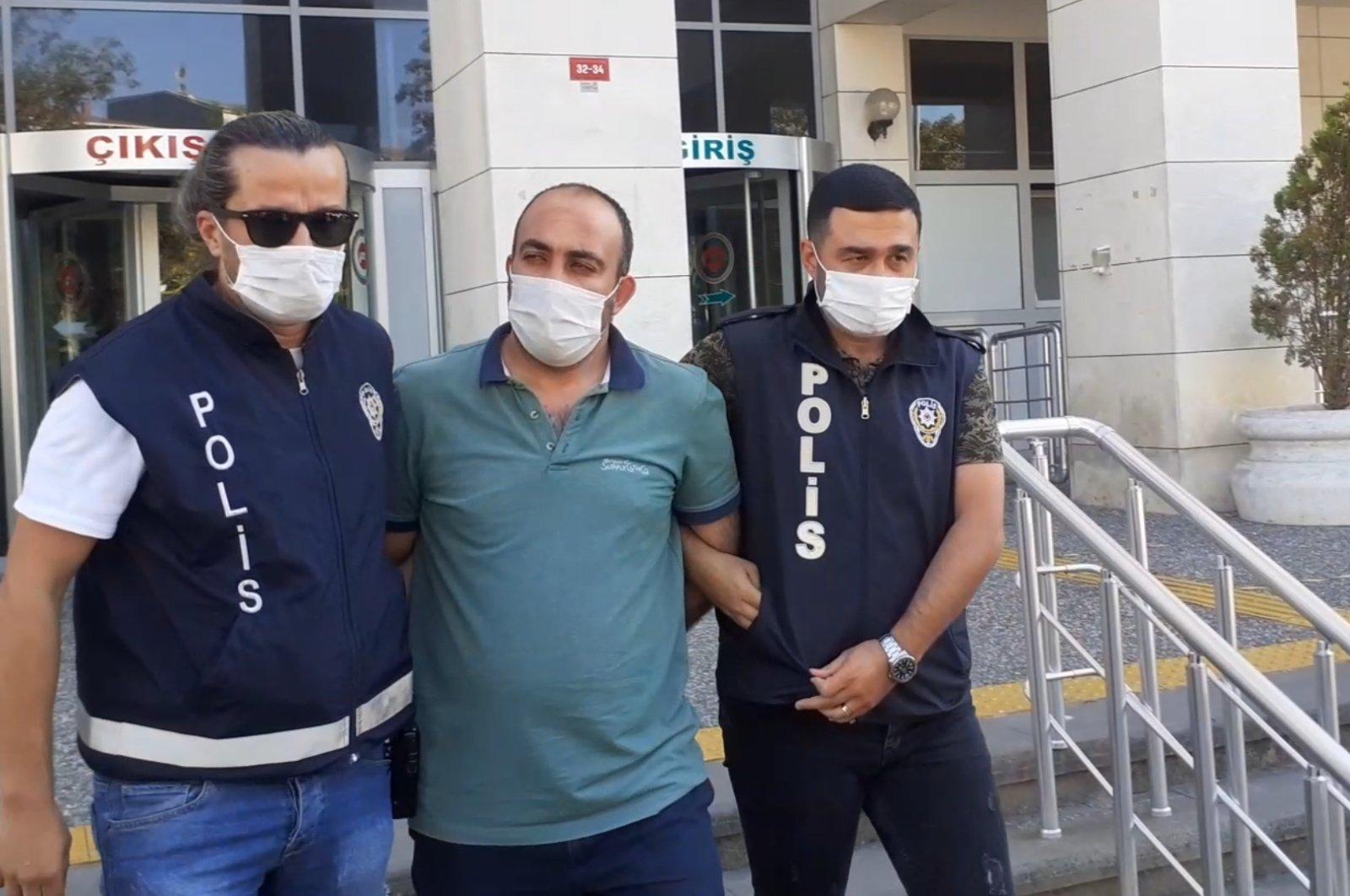 Police escort a captured FETÖ suspect, in Istanbul, Turkey, Aug. 28, 2020. (AA Photo)