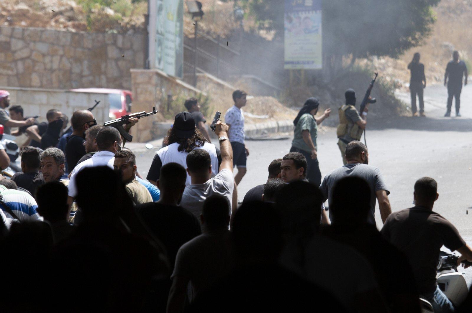 Gunmen open fire on a building in Khaldeh, south of Beirut, Lebanon, Aug. 28, 2020. (AP Photo)