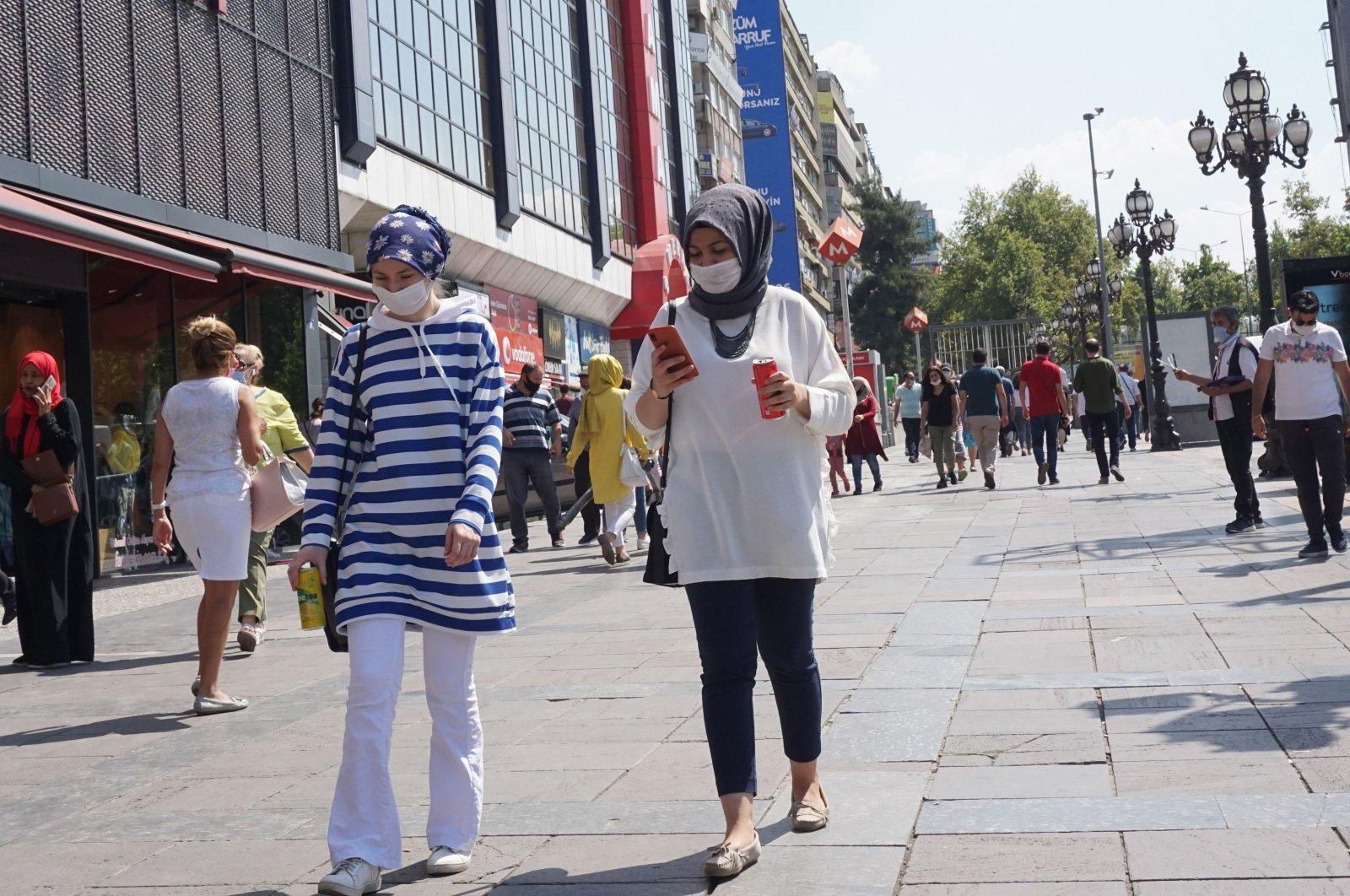 Pedestrians wear face masks as they walk in a street in the capital Ankara, Turkey, Aug. 26, 2020. (AFP Photo)