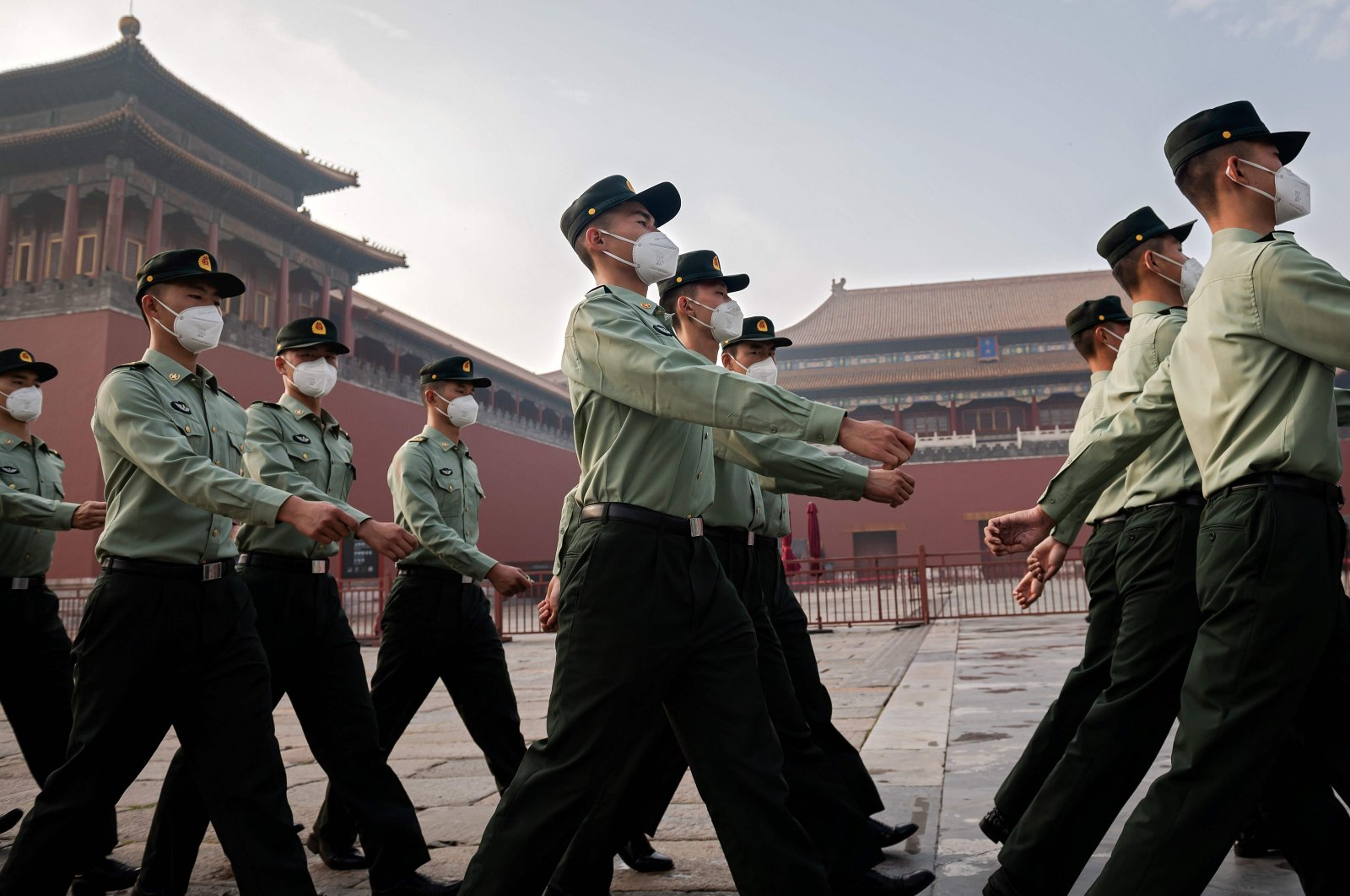 People's Liberation Army (PLA) soldiers march next to the entrance to the Forbidden City during the opening ceremony of the Chinese People's Political Consultative Conference (CPPCC), Beijing, May 21, 2020. (AFP Photo)