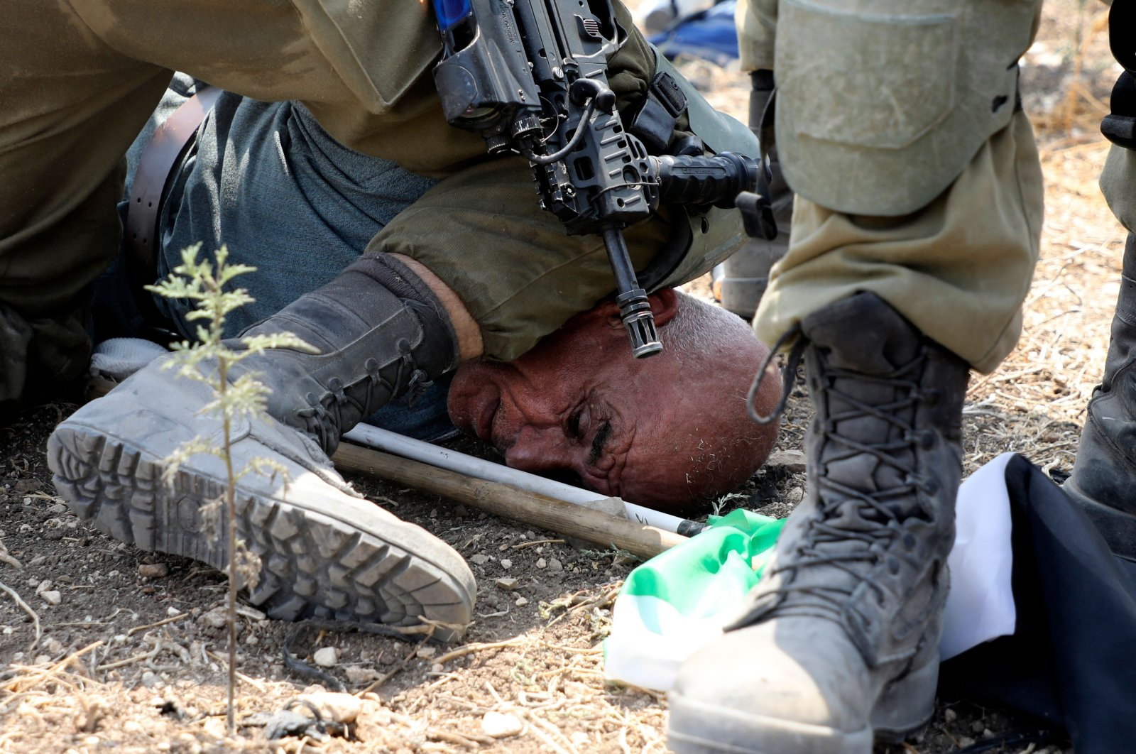 Israeli soldiers detain a Palestinian protester during a demonstration against the Israeli settlement expansion in the village of Shufah, southeast of Tulkarm in the occupied West Bank, Sept. 1, 2020. (AFP Photo)