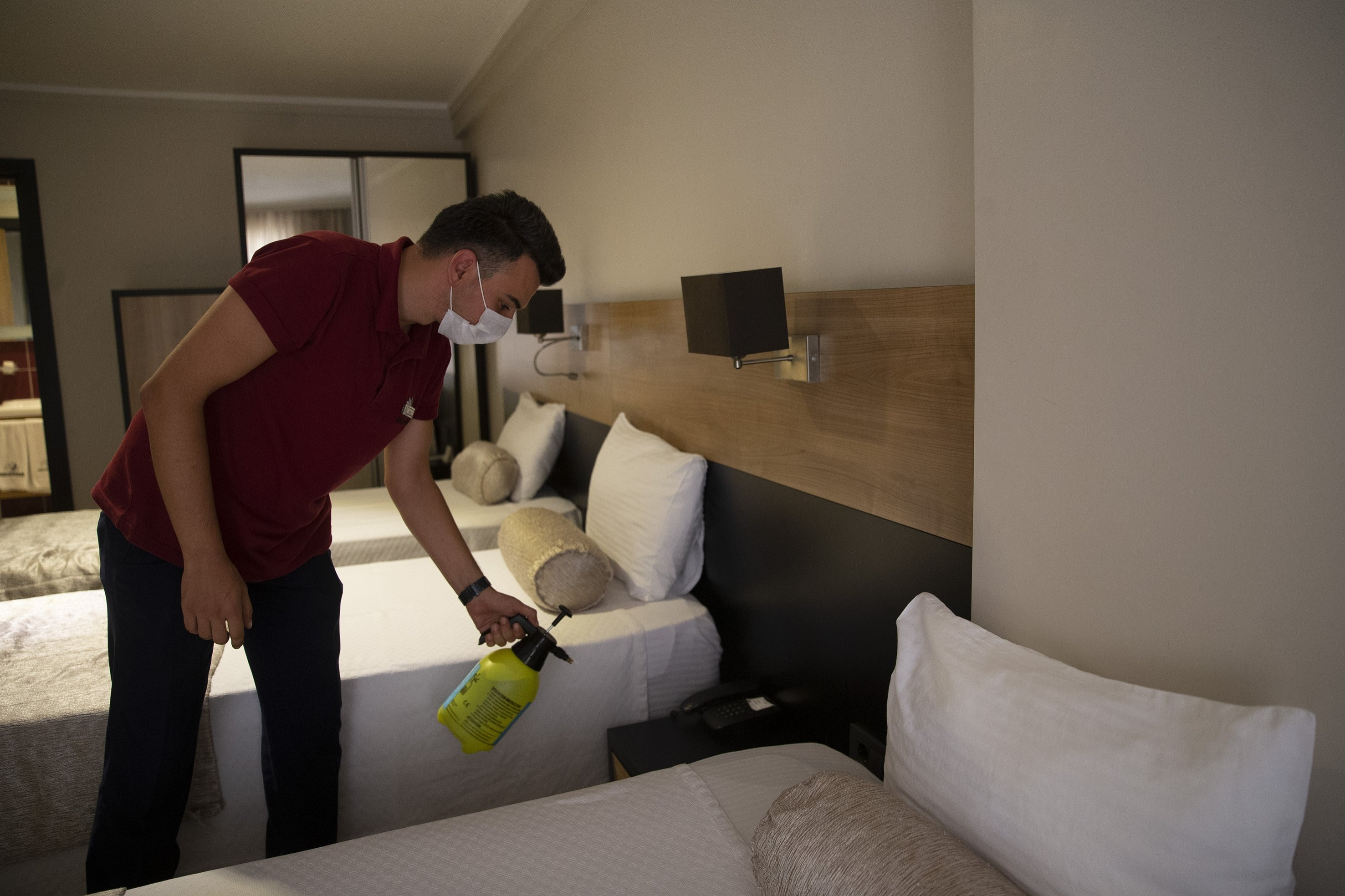 An employee disinfects a hotel room with a sanitizing solution in northwestern Edirne, Turkey, Aug. 29, 2020. (AA Photo)