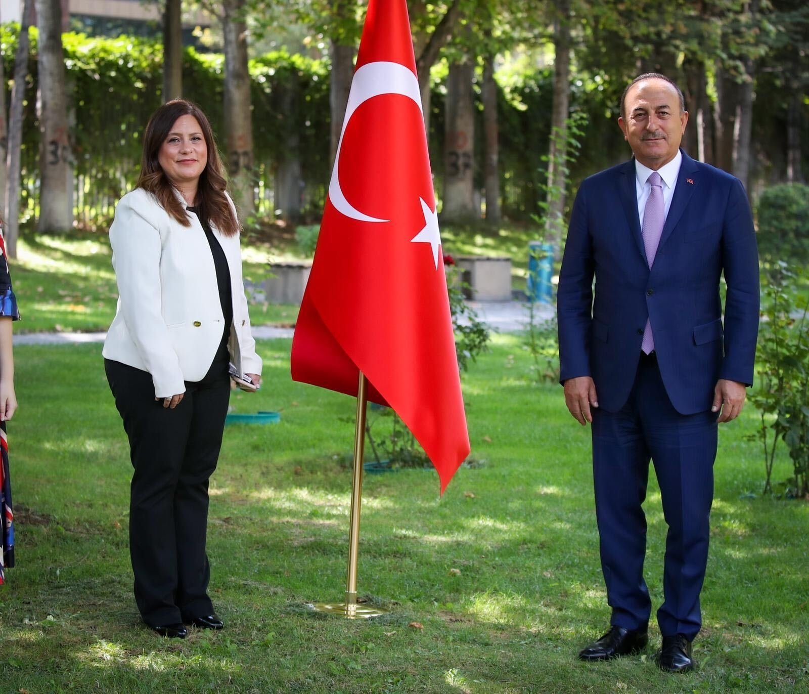 Foreign Minister Mevlüt Çavuşoğlu stands beside Daily Sabah Ankara Representative Nur Özkan Erbay, Ankara, Turkey, Sept. 2, 2020. (Courtesy of the Foreign Ministry)