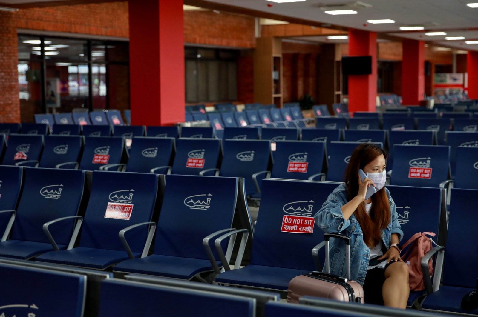 A passenger waits to board her flight at Tribhuvan International Airport after it reopened with limited international flights amid the spread of COVID-19, in Kathmandu, Nepal, Sept. 2, 2020. (Reuters Photo)