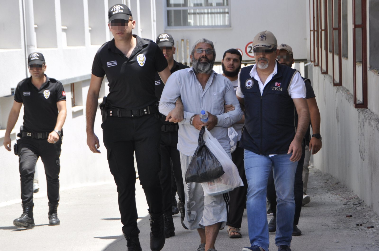 Mahmut Özden, the leader of the Daesh terrorist group in Turkey, is escorted by police in this undated photo. (AA Photo)