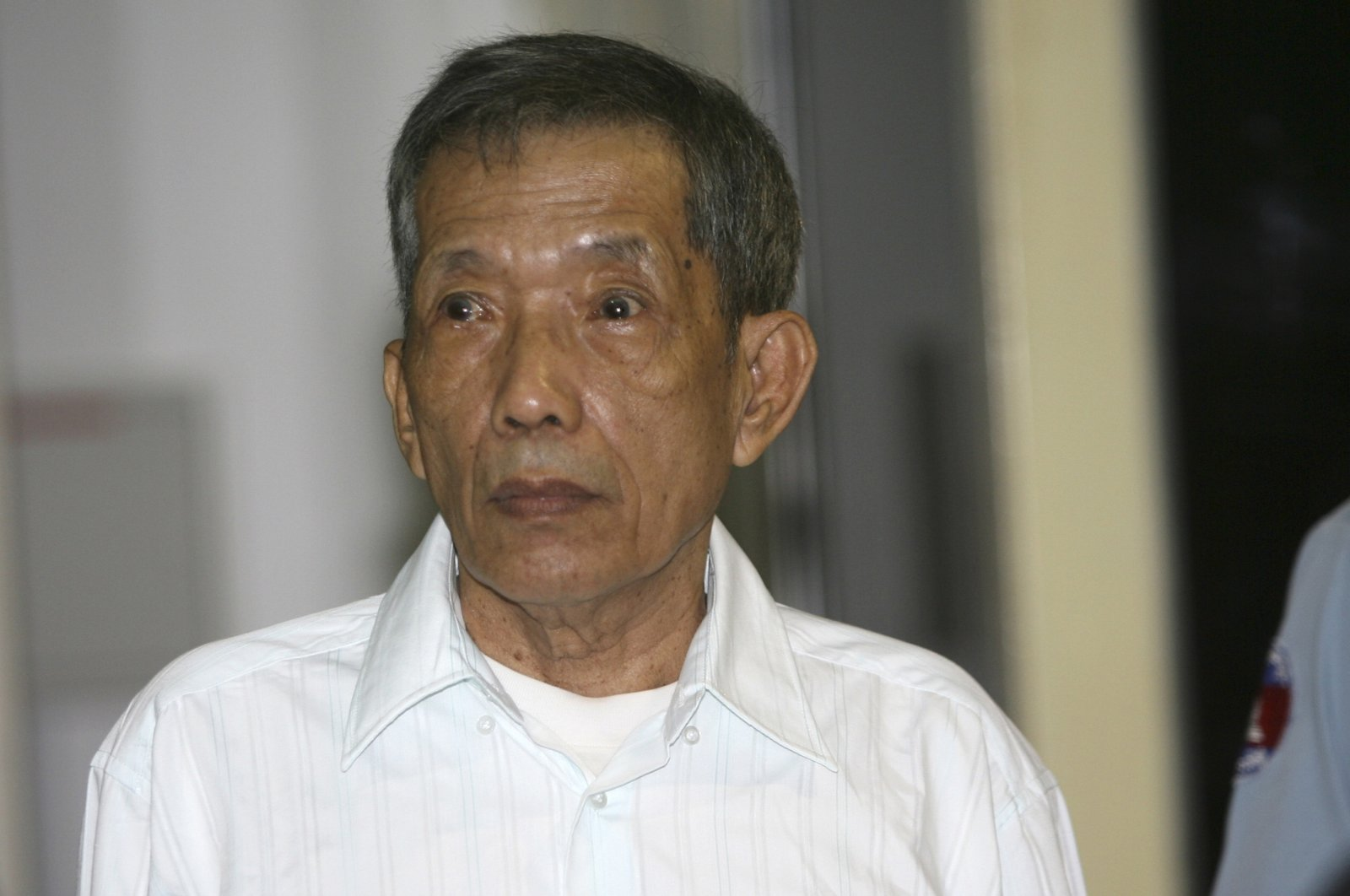 Former Khmer Rouge prison chief Kaing Guek Eav, also know as Duch, looks on during the first day of a U.N.-backed tribunal, Phnom Penh, March 20, 2020. (AP Photo)