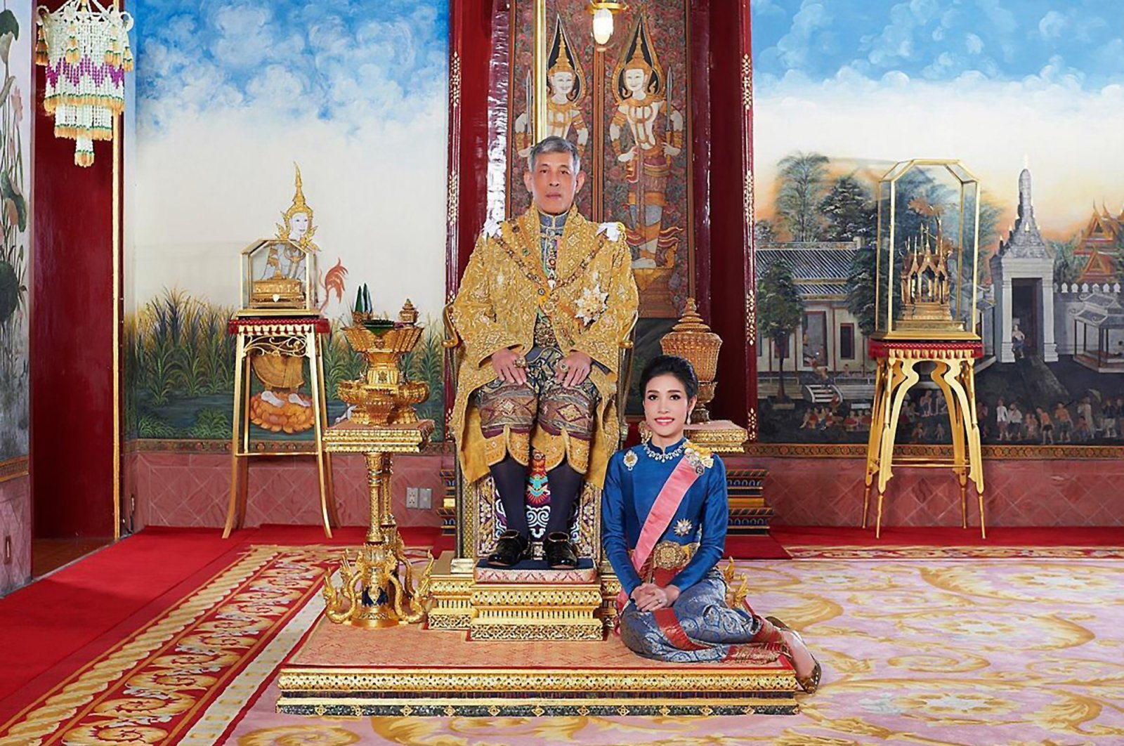 This undated file photo posted on Aug. 26, 2019, on the Thailand Royal Office website shows King Maha Vajiralongkorn with Major General Sineenatra Wongvajirabhakdi, the royal noble consort. (Thailand Royal Office Photo via AP)