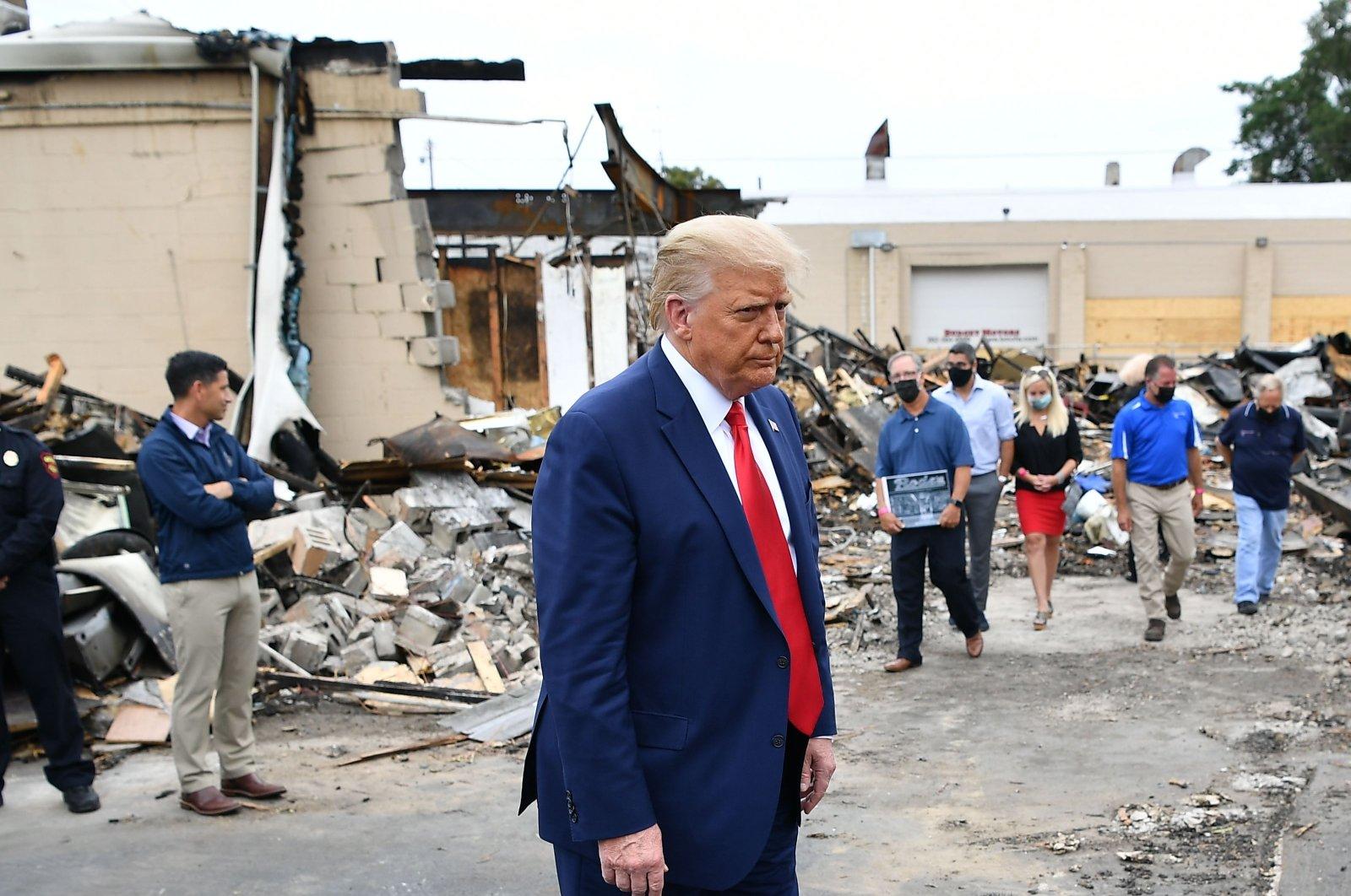 U.S. President Donald Trump tours an area affected by civil unrest, Kenosha, Wisconsin, U.S., Sept. 1, 2020. (AFP Photo)