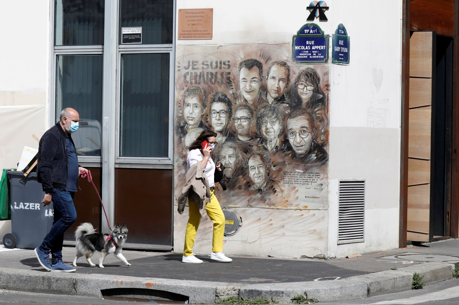 People walk past the artwork of a French street artist, Paris, Aug. 28, 2020. (REUTERS Photo)