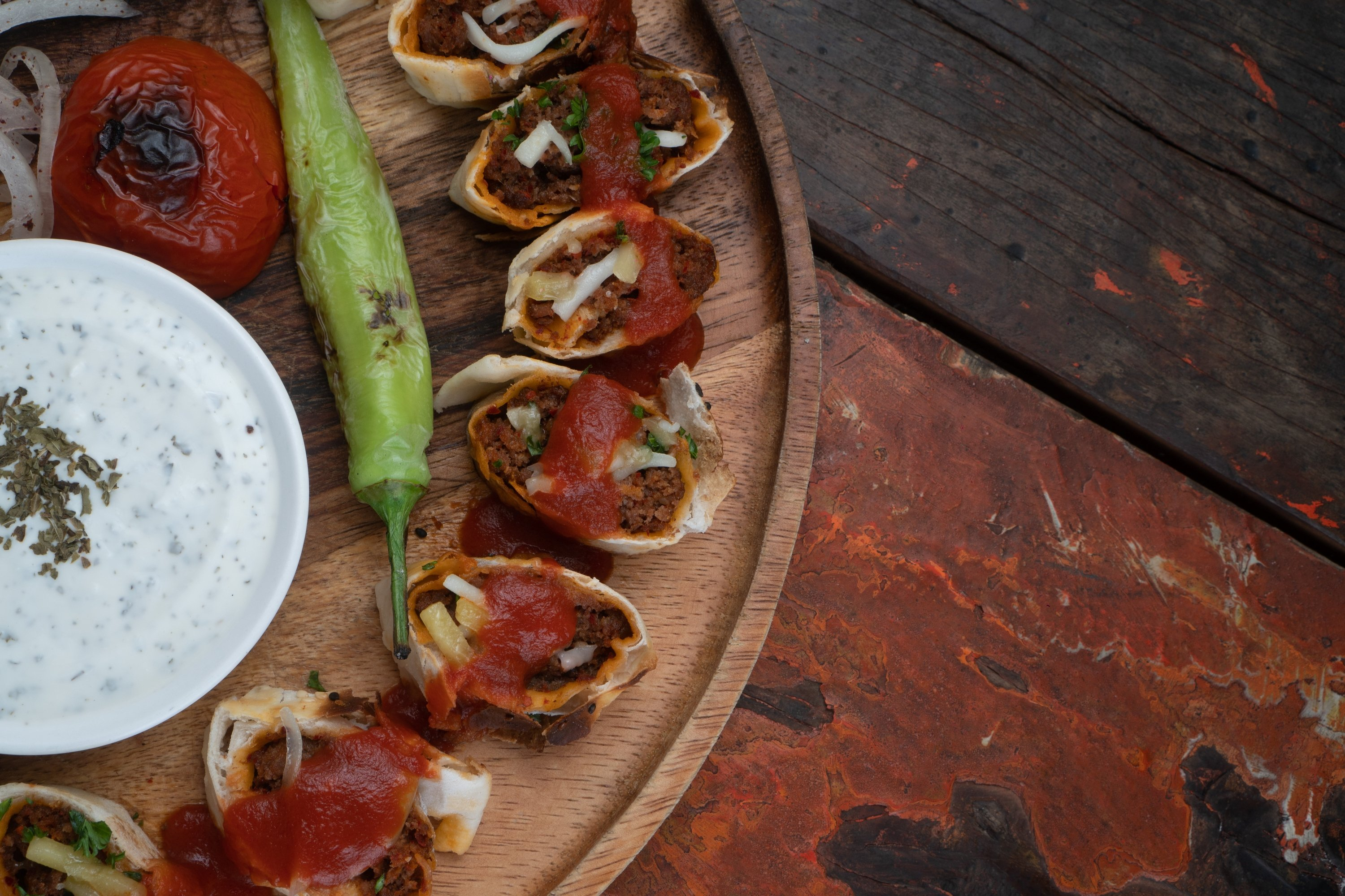 Beyti kebab is wrapped in lavash, a tortilla-like bread, and cut into bite-sized pieces. (Shutterstock Photo)