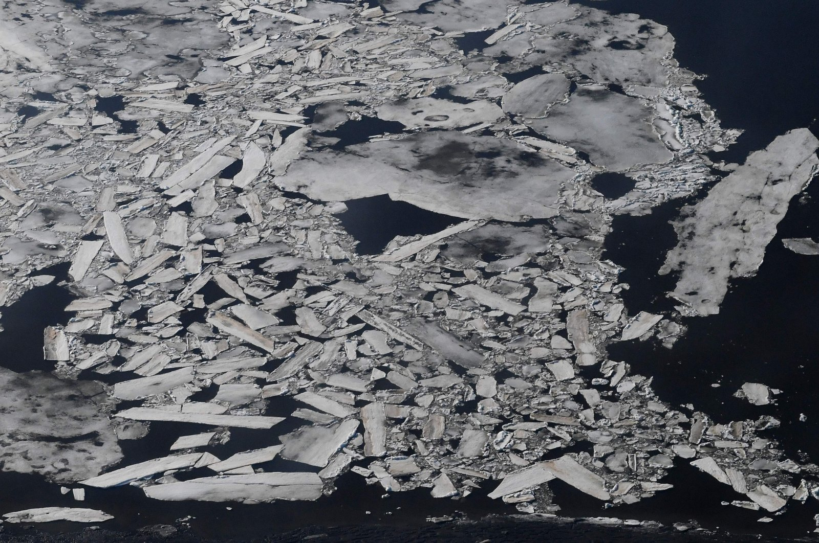 Ice breaks up early on the Kuskokwim River beside the Bering Sea and near the climate change-affected Yupik Eskimo village of Quinhagak on the Yukon Delta in Alaska, April 12, 2019. (AFP Photo)