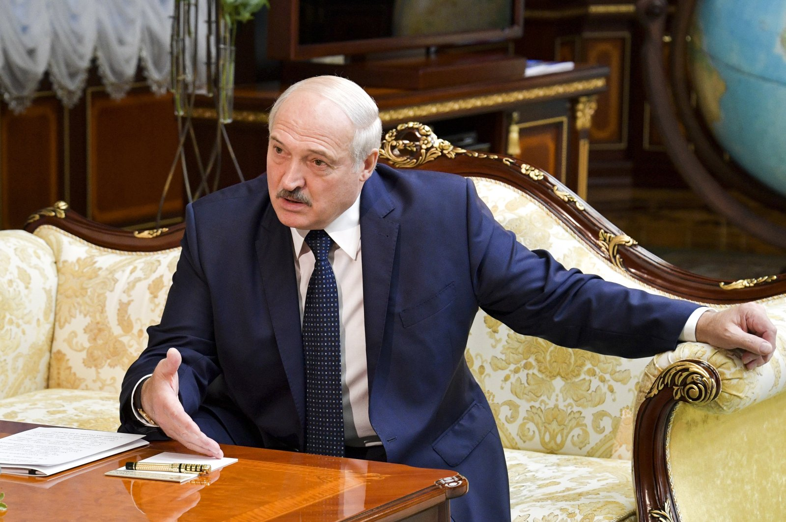 Belarusian President Alexander Lukashenko gestures while speaking to Russian Prime Minister Mikhail Mishustin during their talks in Minsk, Belarus, Sept. 3, 2020. (AP Photo)