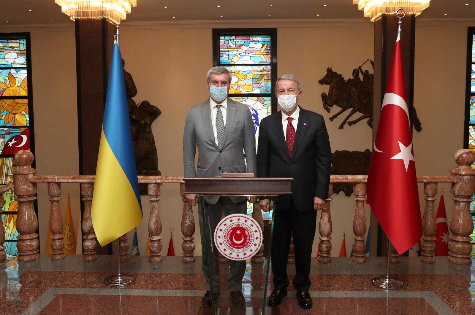 Ukrainian Vice Prime Minister Oleh Urusky (L) poses with Turkish Defense Minister Hulusi Akar during an official visit to Ankara, Turkey, Sept. 1, 2020. (AA Photo)