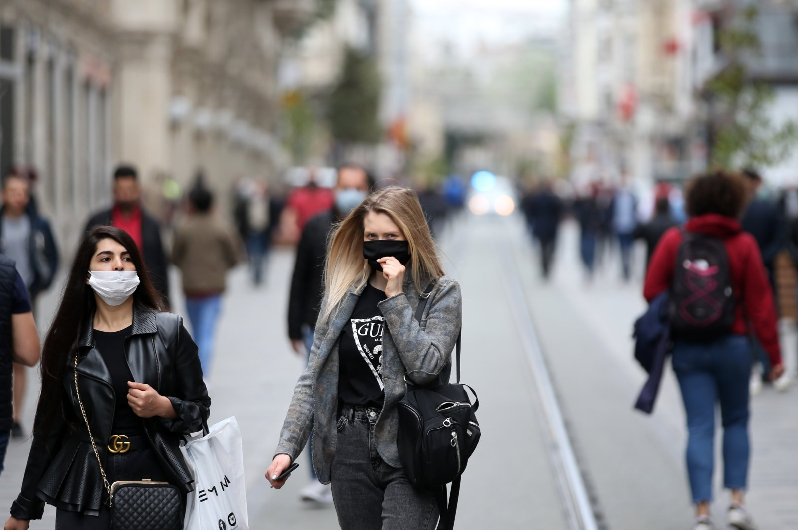 Two women walk on Istiklal Avenue wearing masks to protect against COVID-19, in Istanbul, Turkey, May 8, 2020. (AA Photo)