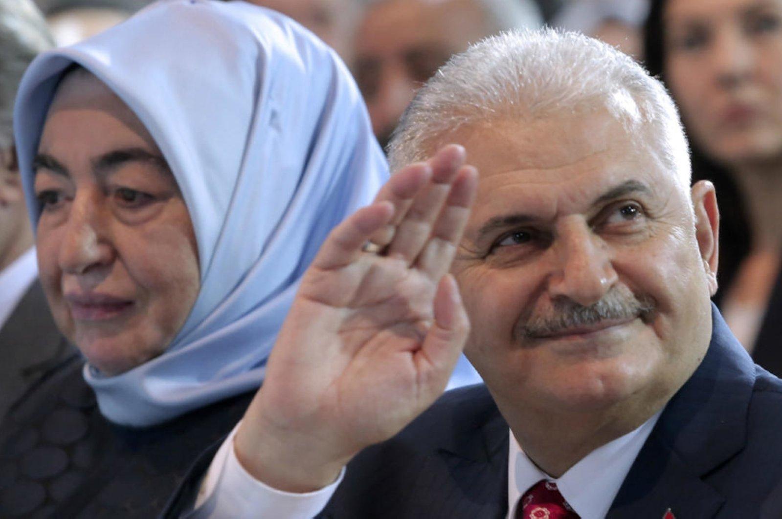 Former Prime Minister and AK Party Izmir deputy Binali Yıldırım (R) and his wife Semiha Yıldırım (L) during a congress of his party in Ankara, Turkey, May 22, 2016. (AFP Photo)