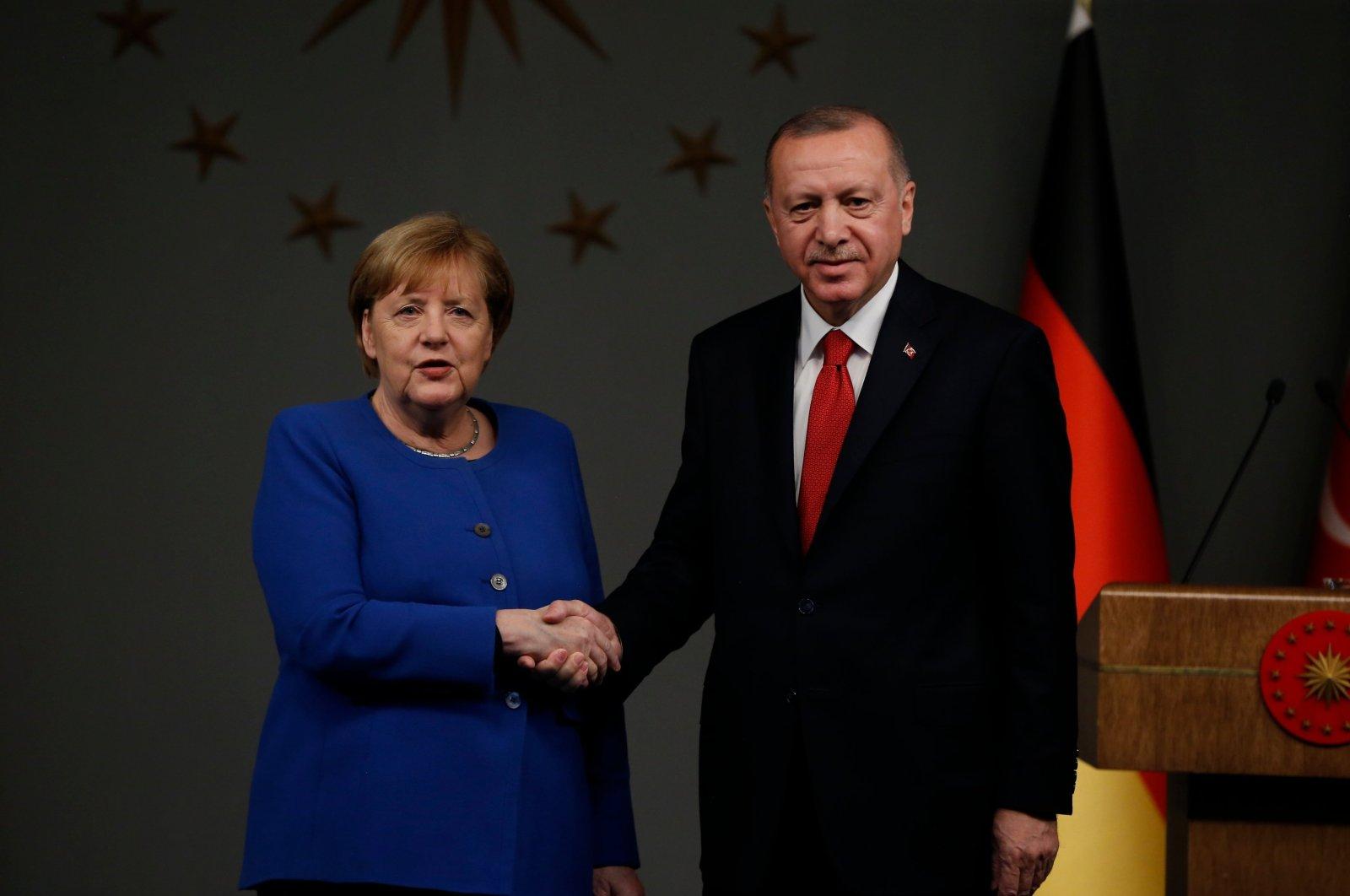Germany's Chancellor Angela Merkel shakes hands with Turkey's President Recep Tayyip Erdoğan following a joint news conference, Istanbul, Turkey, Jan. 24, 2020. (AP Photo)