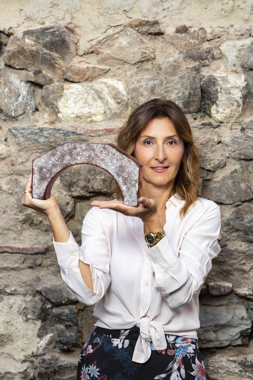 "Felekşan Onar poses with one of the glass pieces in her work titled ""41X."" (Courtesy of Felekşan Onar)"