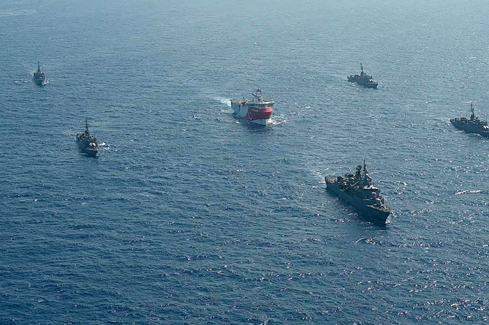 Turkish seismic research vessel Oruç Reis (C) as it is escorted by Turkish Naval ships in the Mediterranean Sea, off Antalya, Aug. 10, 2020. (AFP)
