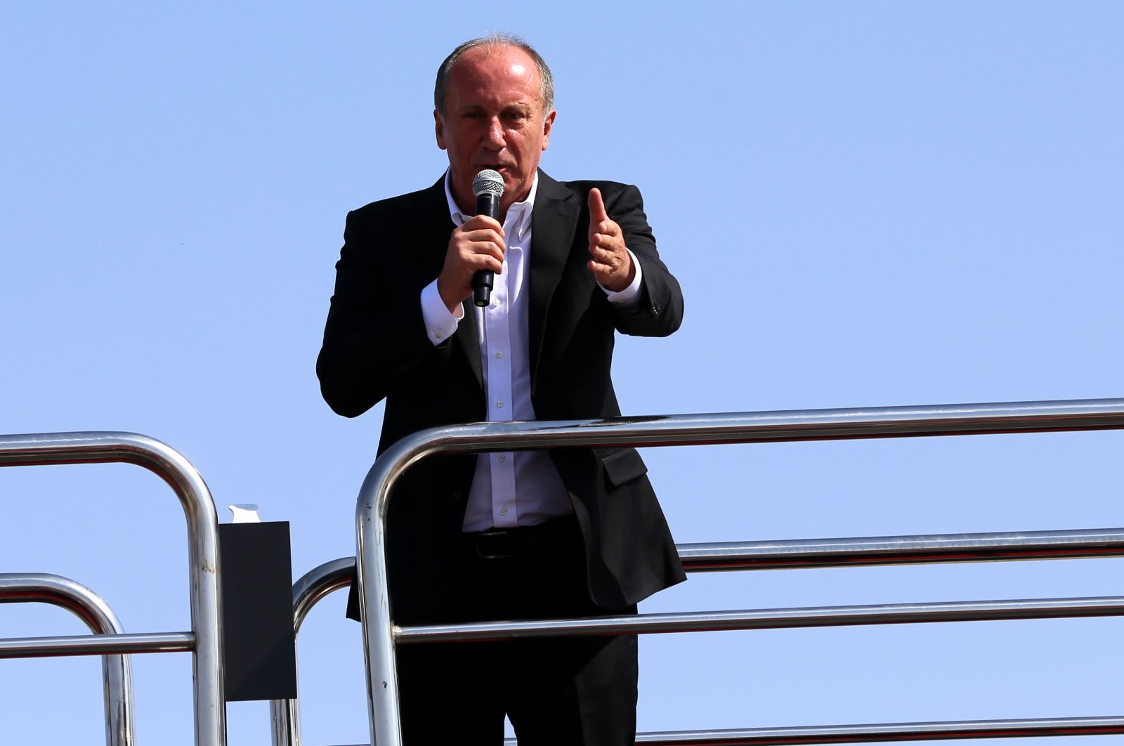 Muharrem Ince addresses people on the top of a bus in Sivas province, Turkey, Sept. 4, 2020. (AA Photo)