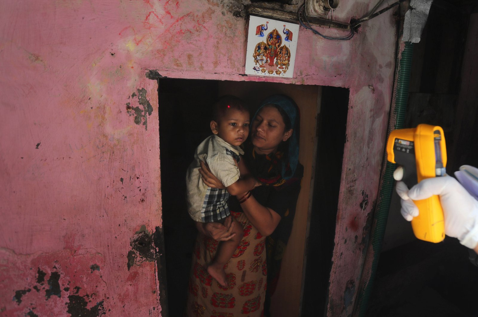 A health worker screens people for symptoms of COVID-19, Dharavi, Mumbai, Sept. 4, 2020. (AP Photo)