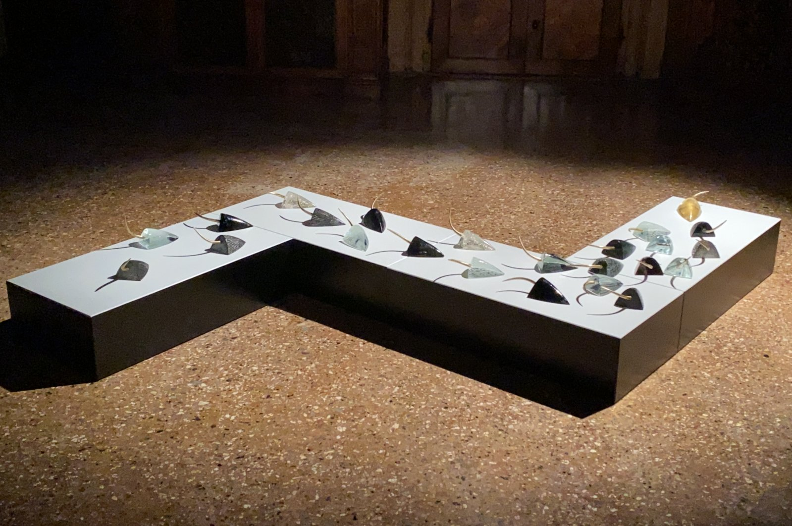 "Felekşan Onar, ""ENCODE,"" installation of hot-formed and cold-cut mice figures with metal cast tails. (Courtesy of Felekşan Onar)"