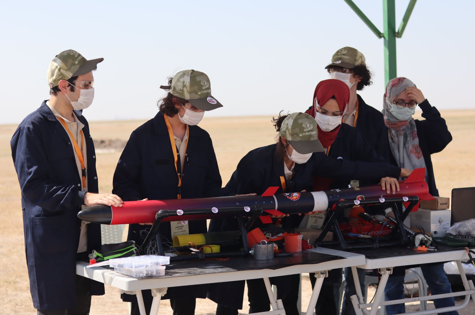 """Sixteen-year-old Emirhan Kayiş (2nd from L) works with his team """"Halley's Apprentices"""" during the Teknofest Rocket Competition in Turkey's central Aksaray province, Sept. 4, 2020. (Daily Sabah Photo)"""
