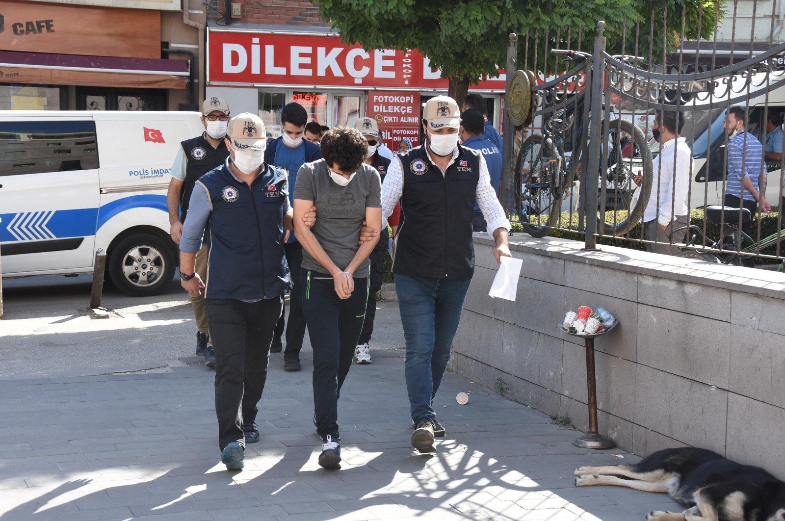 Police escort a FETÖ suspect captured in Eskişehir, central Turkey, Sept. 4, 2020. (DHA Photo)
