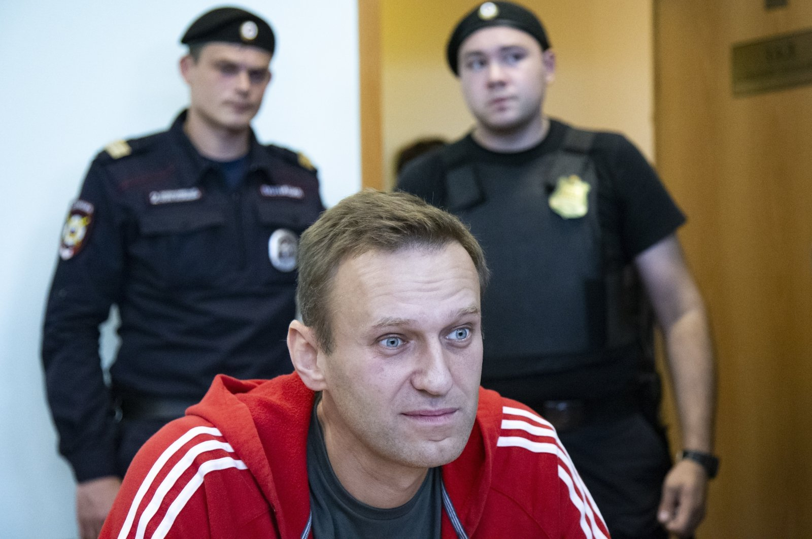 Russian opposition leader Alexei Navalny speaks to the media prior to a court session in Moscow, Russia, Aug. 22, 2019. (AP Photo)