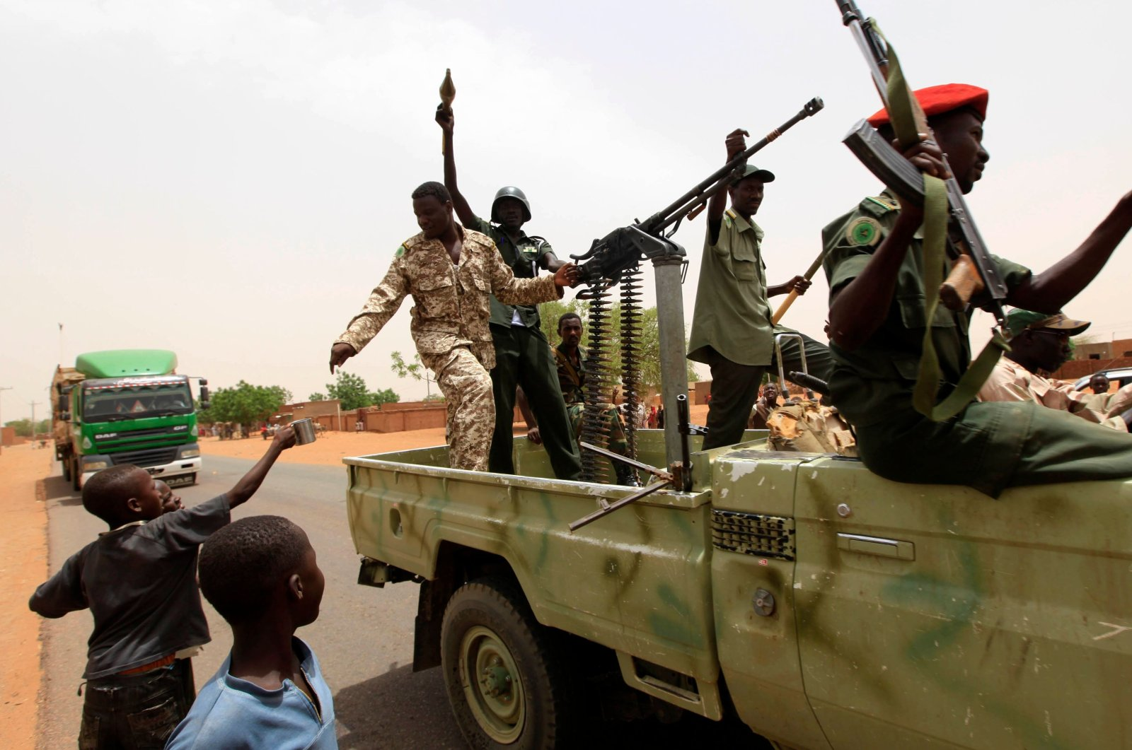 In this file photo, Sudanese forces celebrate after reportedly regaining control of the district of Abu Kershola, a town in which rebels of the Sudan Revolutionary Front coalition seized on April 27, in South Kordofan on May 28, 2013. (AFP Photo)