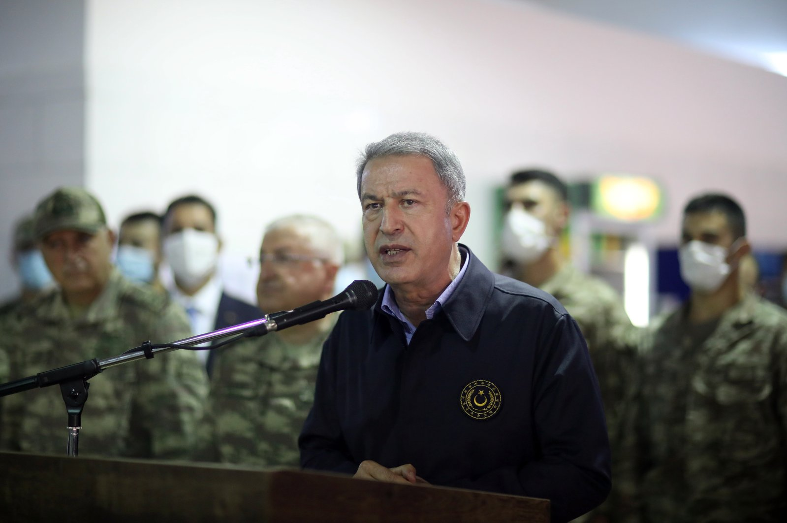 A handout picture made available by the Defense Ministry shows National Defense Minister Hulusi Akar speaking as he visits the Defense Security Cooperation and Training Assistance Advisory Command, which was created under the military cooperation memorandum of understanding (MoU) with Libya, in Tripoli, Libya, 17 August 2020.  (EPA / TURKISH DEFENSE MINISTRY HANDOUT)