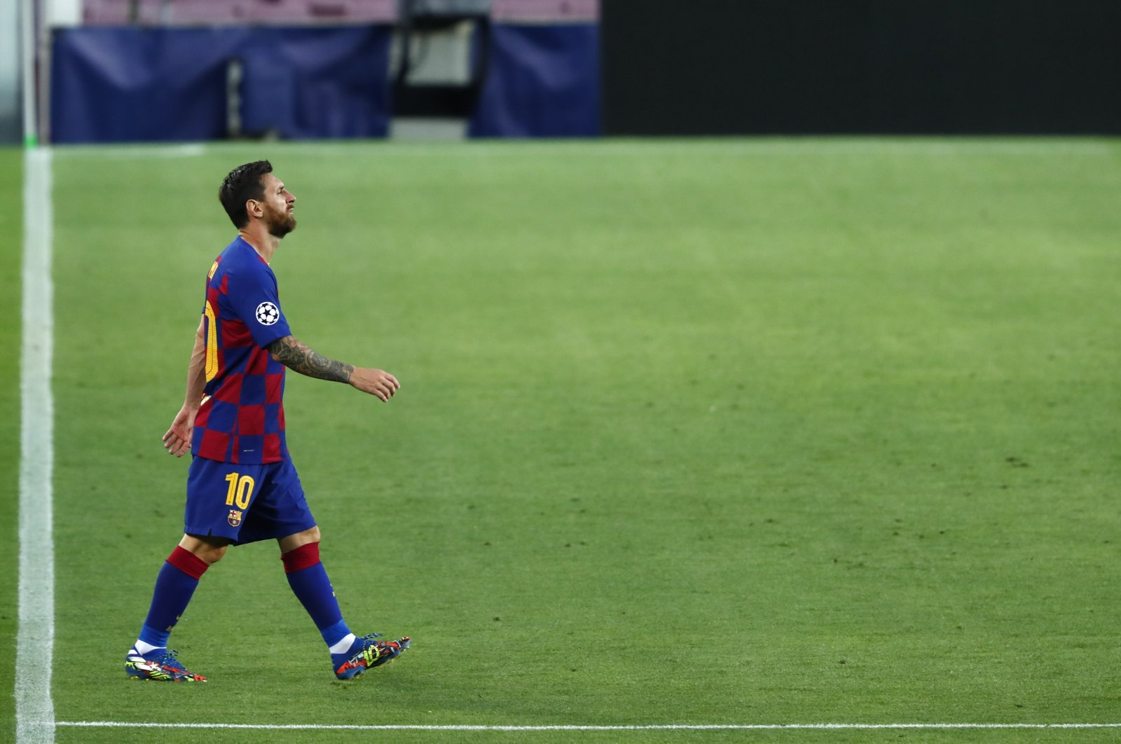 Barcelona's Lionel Messi walks on the field for the Champions League round of 16, second leg football match between Barcelona and Napoli at the Camp Nou Stadium in Barcelona, Spain, Saturday, Aug. 8, 2020. (AP Photo)