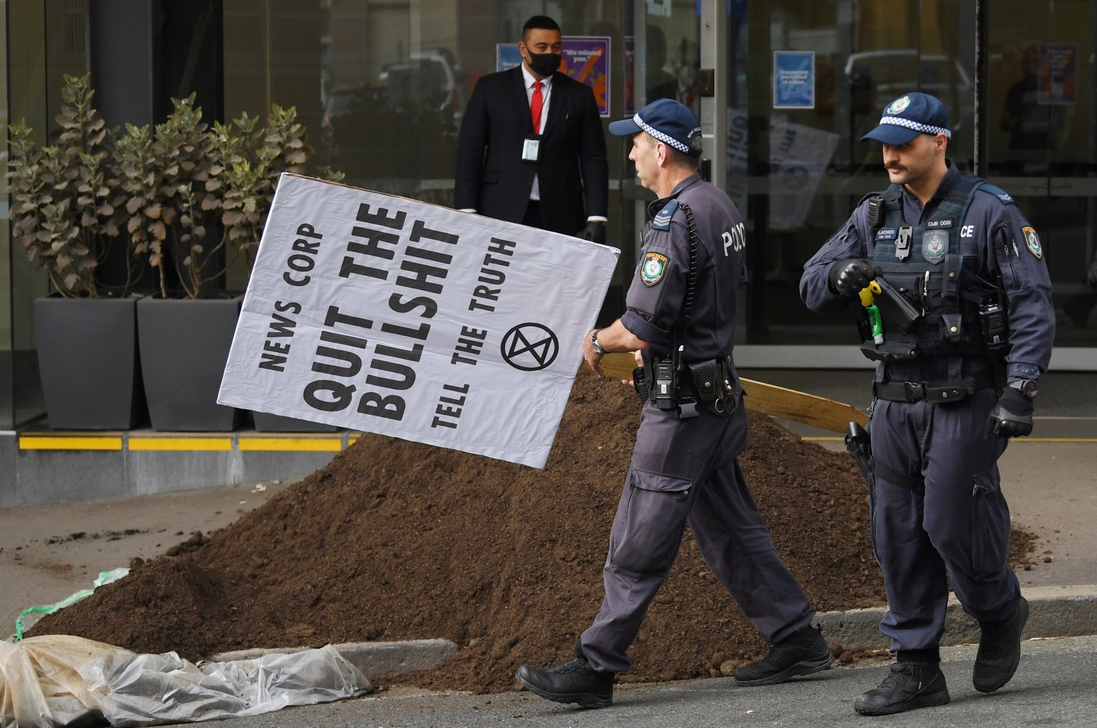 """A pile of """"manure"""" is dumped outside the News Corp Australia offices in Sydney, Australia, Sept. 4, 2020. (EPA Photo)"""