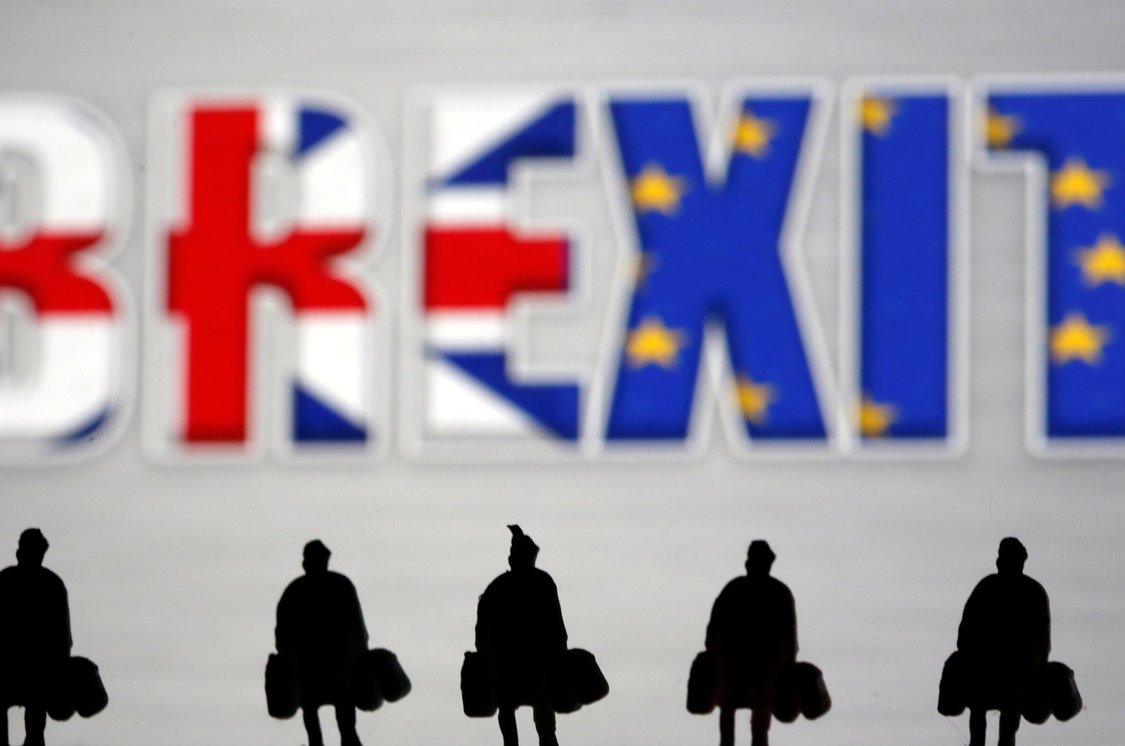 Small toy figures are seen in front of a Brexit logo in this illustration picture, March 30, 2019. (Reuters Photo)