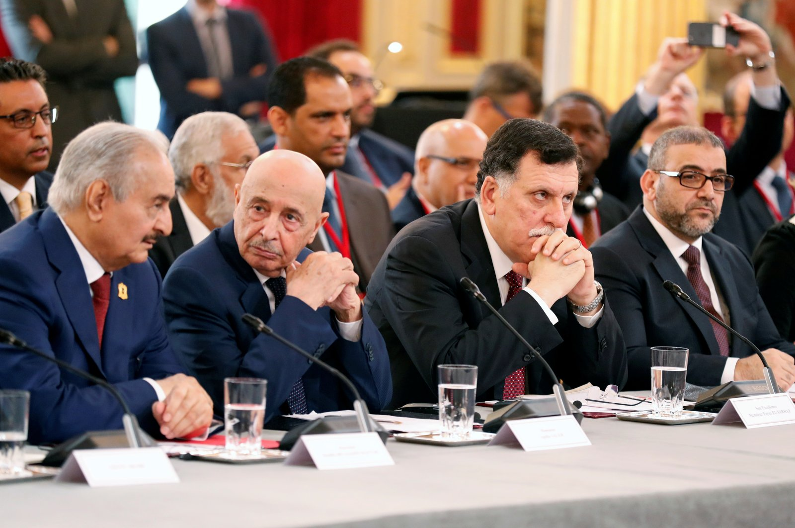 From left to right, Khalifa Haftar, the Libyan warlord, Aguila Saleh Issa, president of the eastern Libyan House of Representatives, Libyan Prime Minister Fayez al-Sarraj and Khaled Al-Mishri, president of Libya High Council of State, during an international conference on Libya at the Elysee Palace in Paris, France, May 29, 2018. (Reuters Photo)