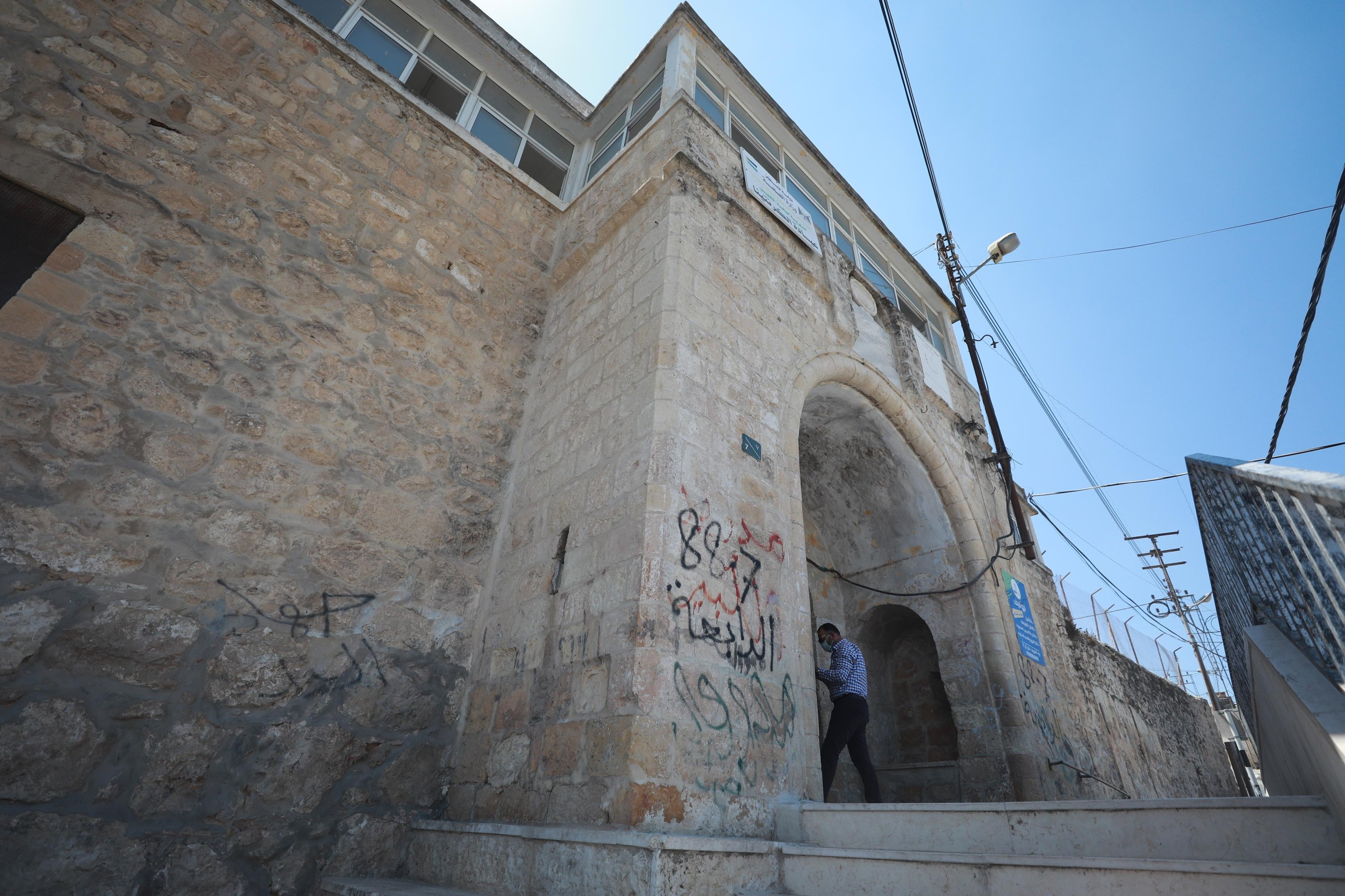The main door of the Tahaffuzhane has an inscription saying that it was built in 1848 during the reign of Sultan Abdülmecid, Hebron, southern West Bank, Sept. 3, 2020. (AA PHOTO)