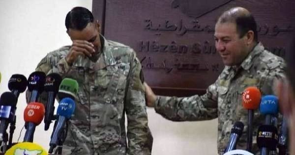 Operation Inherent Resolve Spokesman Col. Myles B. Caggins III cries during a news conference in this CCTV image captured from video