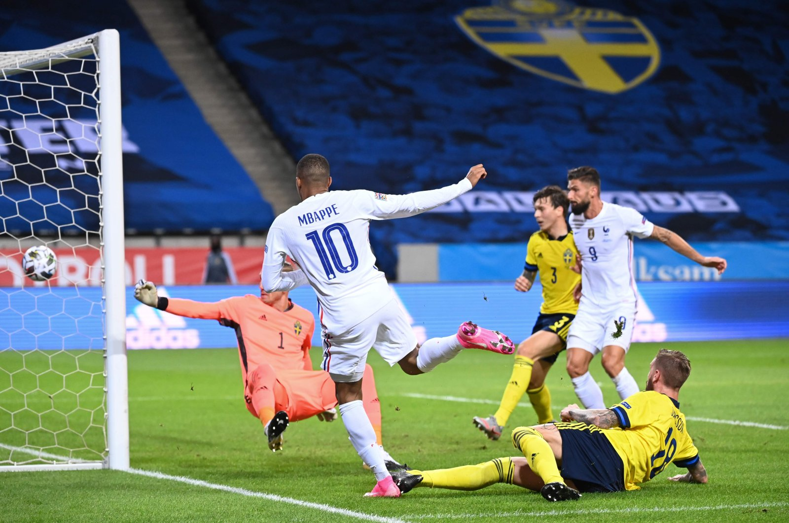 France's Kylian Mbappe scores the opening goal during the UEFA Nations League football match against Sweden in Stockholm, Sweden, Sept. 5, 2020. (AFP Photo)