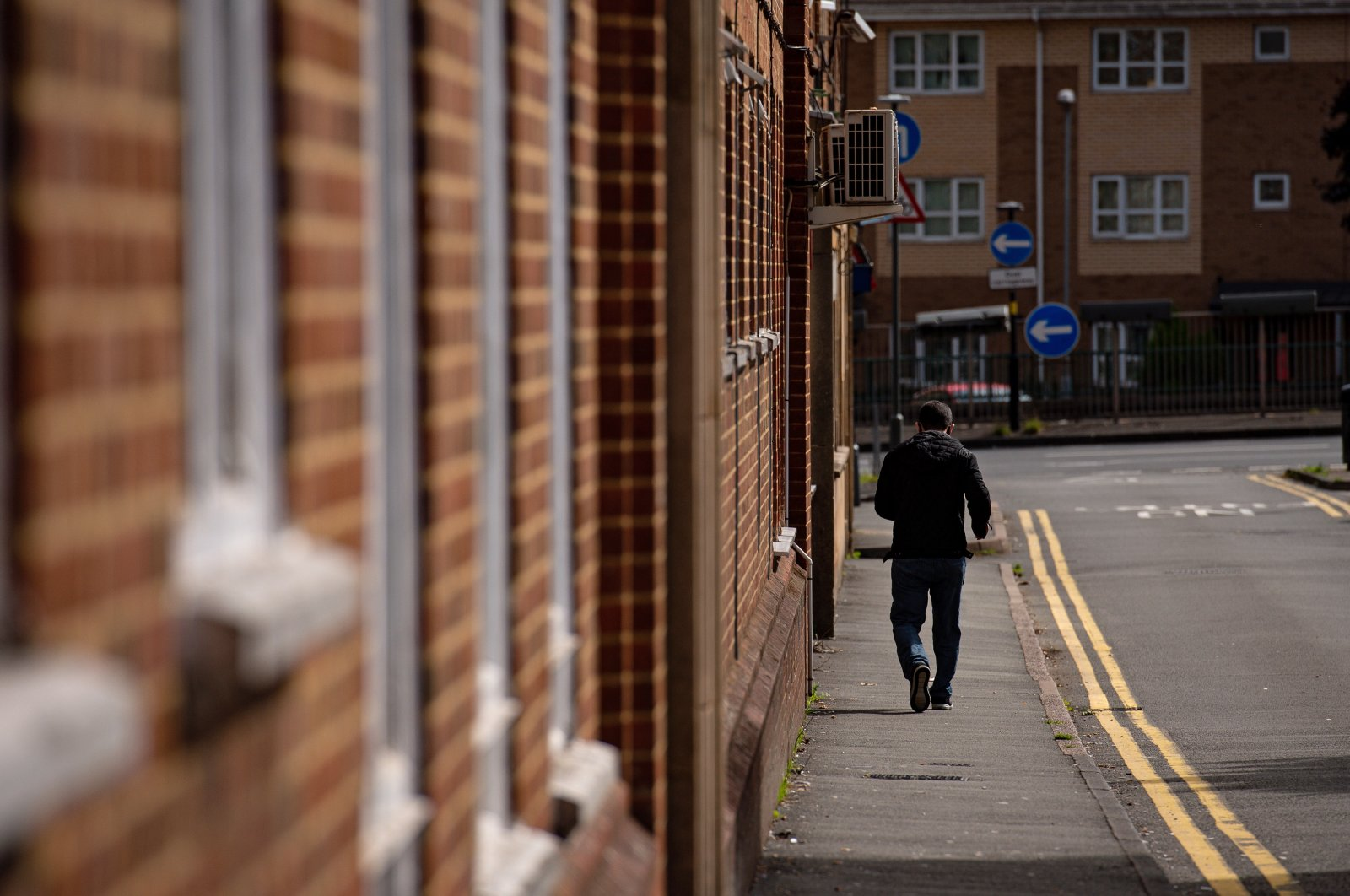 A man walks past The Stone Road hostel in Edgbaston, which has been closed following an outbreak of the coronavirus, Birmingham, Sept. 5, 2020. (Reuters Photo)