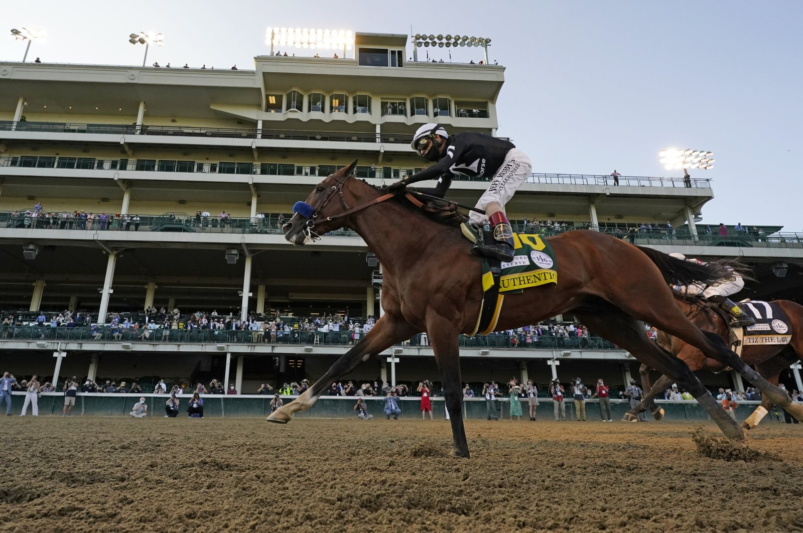 Jockey John Velazquez riding Authentic crosses the finish line to win the 146th running of the Kentucky Derby in Louisville, Kentucky, Sept. 5, 2020. (AP Photo)