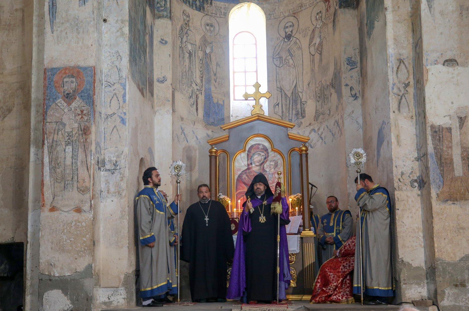 Armenian Orthodox Patriarch Sahak Maşalyan conducts the annual service at Akdamar Church in Van, Turkey, Sept. 6, 2020. (AA Photo)