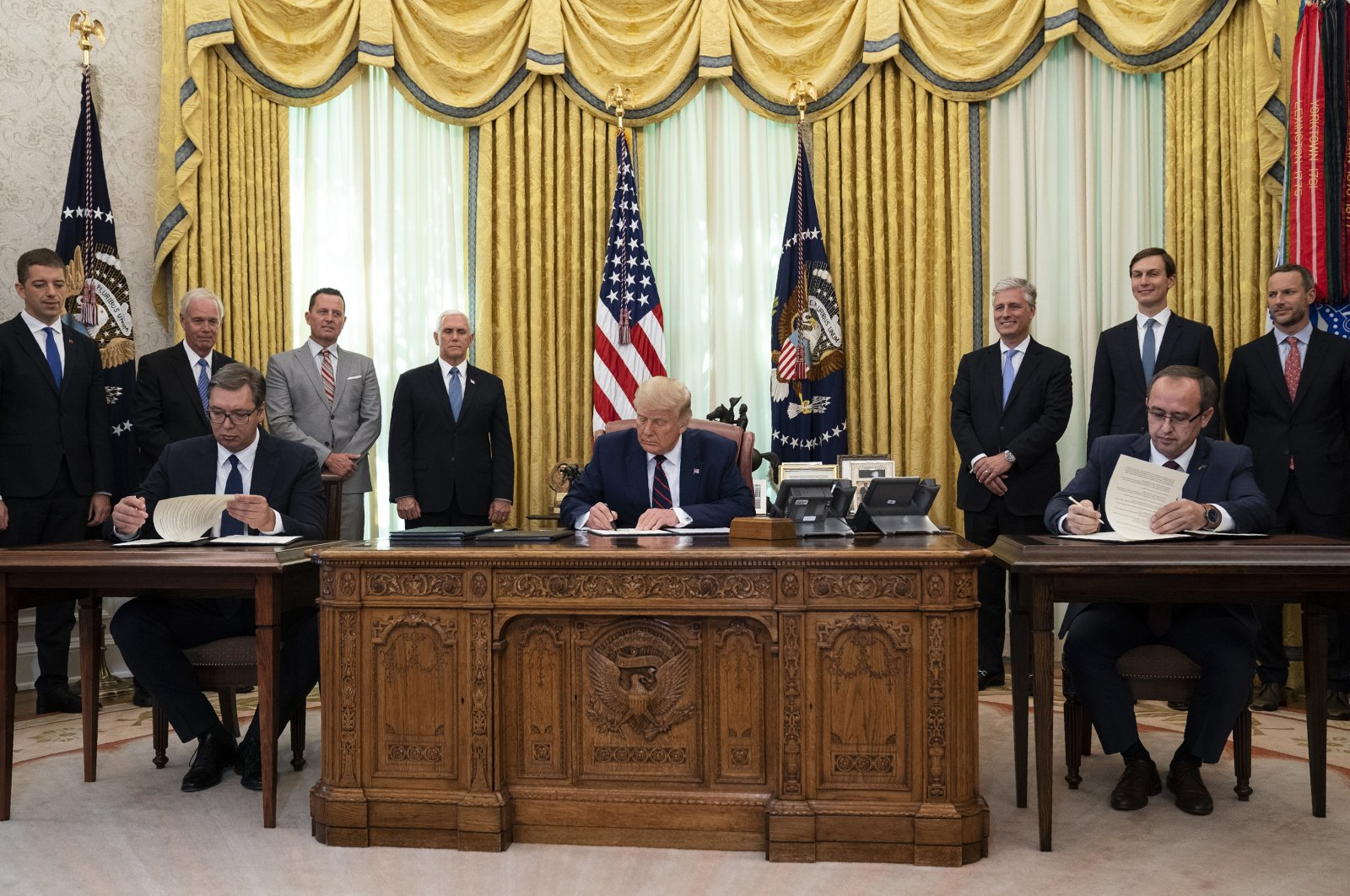 U.S. President Donald Trump participates in a signing ceremony with Serbian President Aleksandar Vucic, left, and Kosovar Prime Minister Avdullah Hoti, in the Oval Office of the White House, Friday, Sept. 4, 2020, in Washington. (AP Photo)
