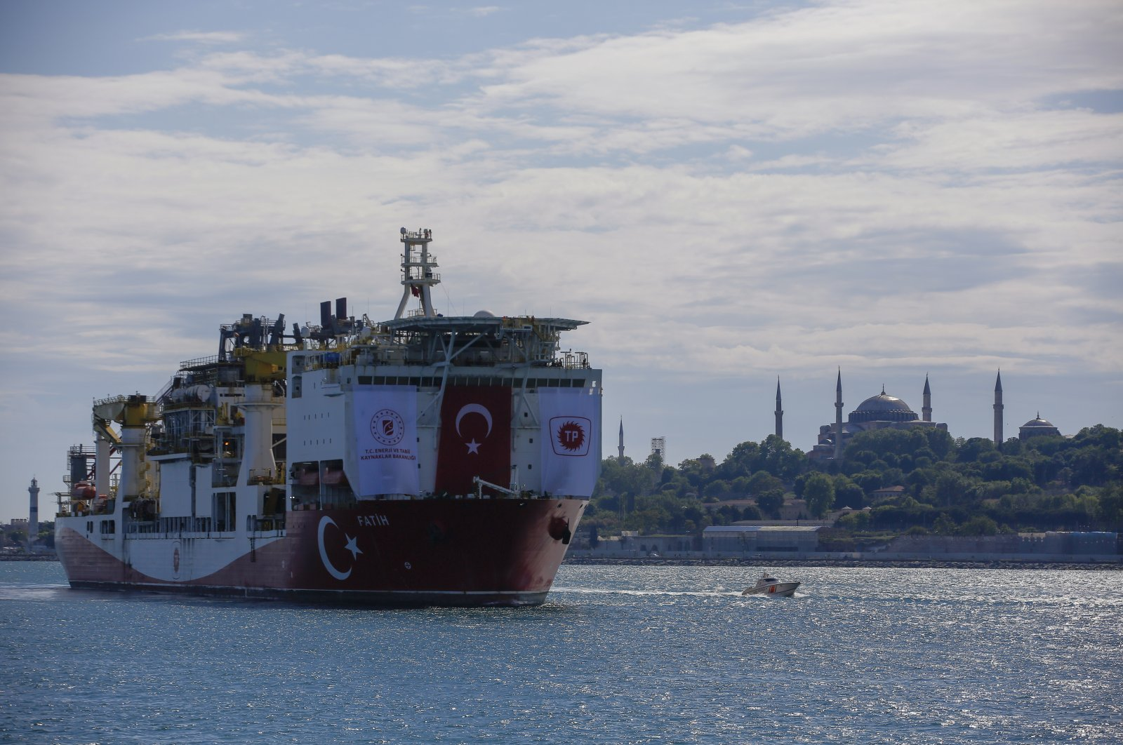 Turkey's drilling ship, Fatih, heads toward the Black Sea with Hagia Sophia in the background, in Istanbul, Turkey, May 29, 2020. (AP Photo)