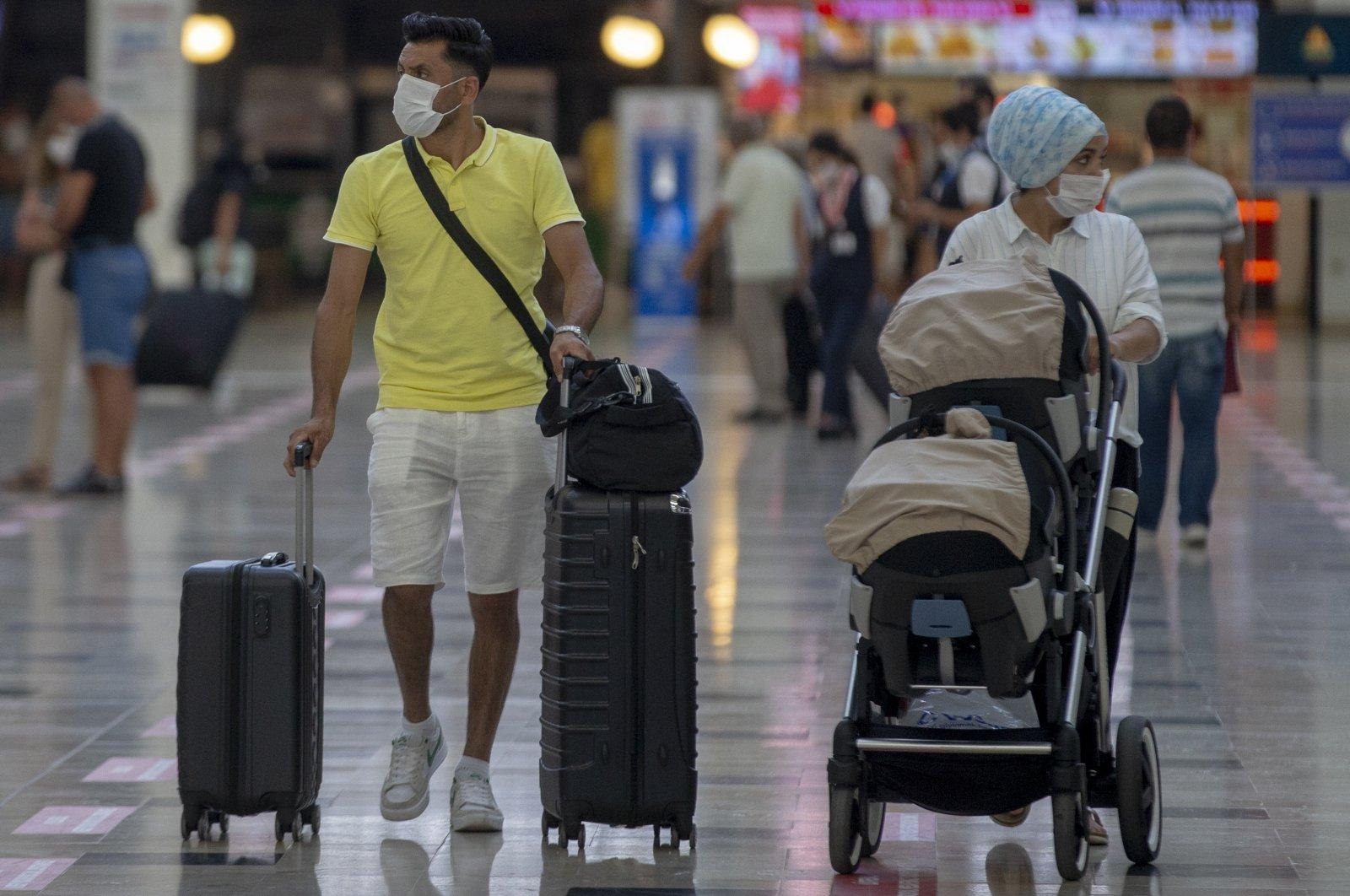 Passengers at Antalya Airport in southern Antalya province, Turkey, Aug. 15, 2020. (AA Photo)