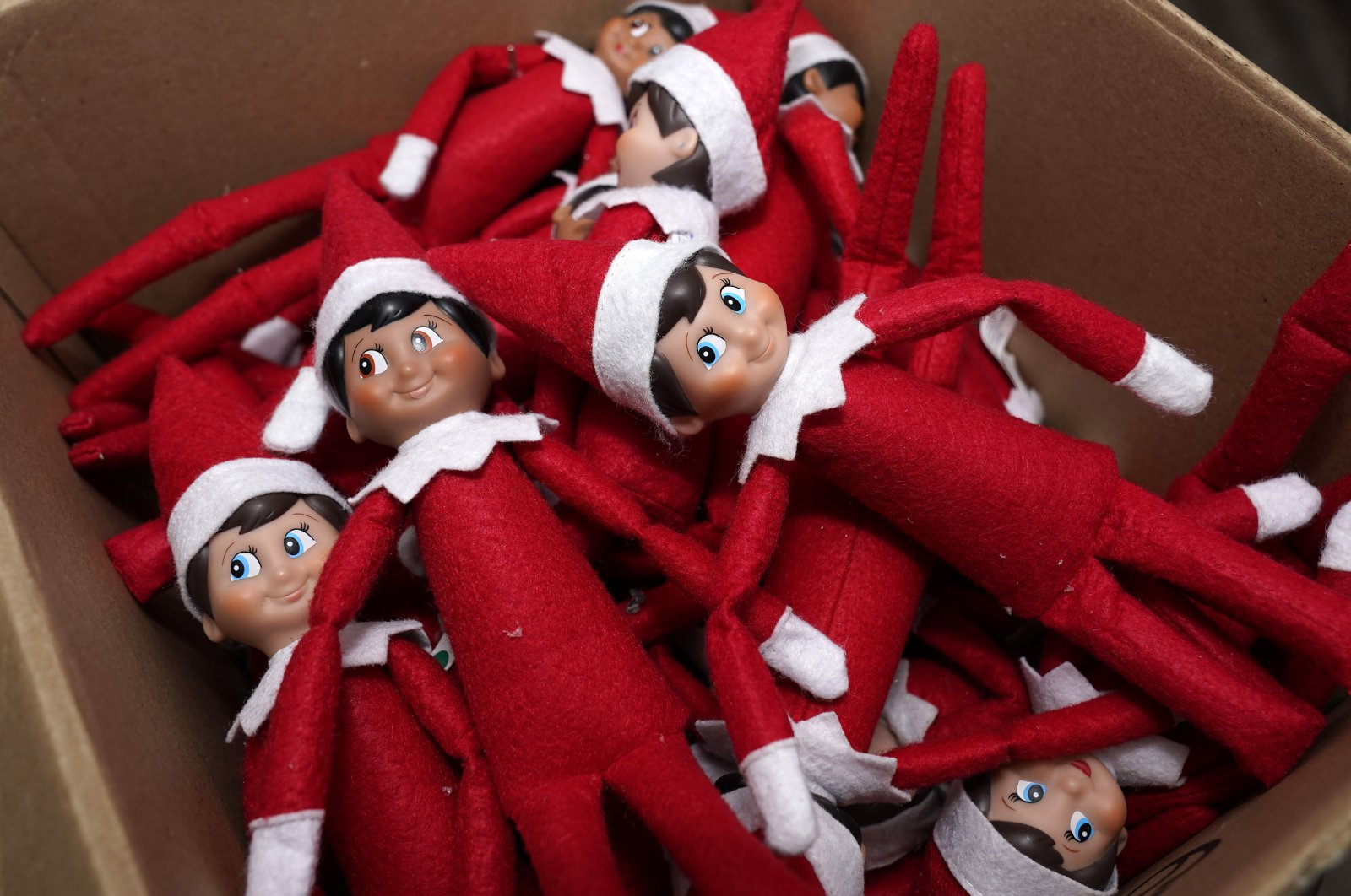 Elf on the Shelf figures are piled in a box at the Lumistella Company's studio in Atlanta, the U.S., Aug. 27, 2020. (AP Photo)