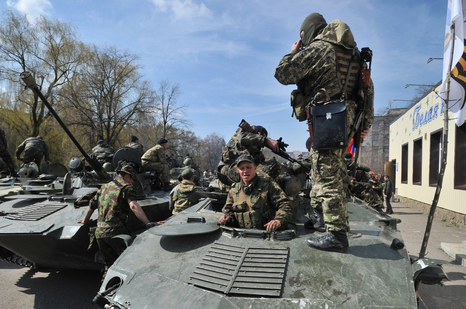 Armed men wearing military fatigues gathered on armored personnel carries in the eastern Ukrainian city of Slovyansk in this undated picture. (AFP Photo/Getty Images)
