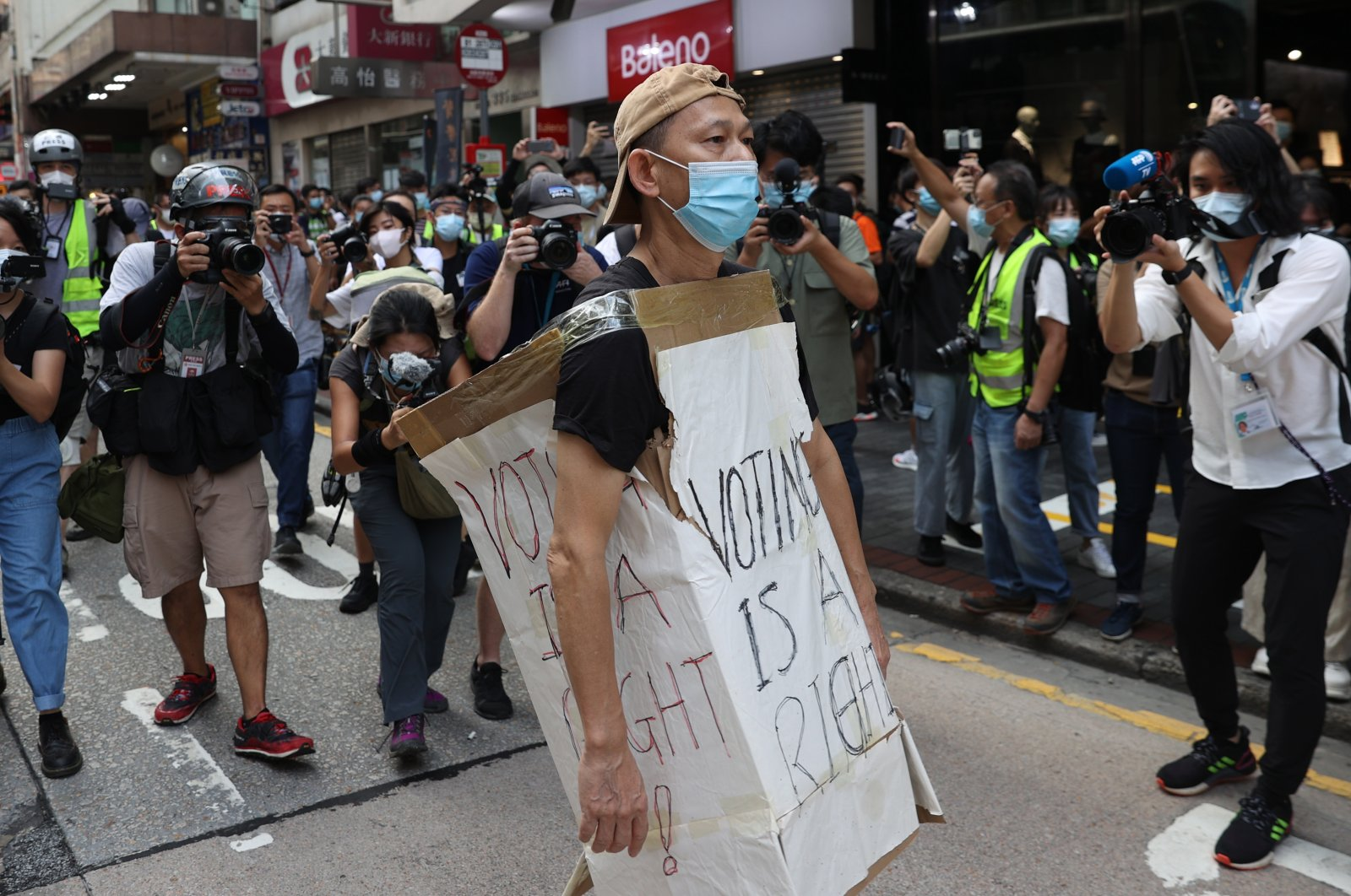 A protester wearing a cardboard sign takes part in a rally against the postponement of the Legislative Council Elections in Hong Kong, China, Sept. 6, 2020. (EPA Photo)